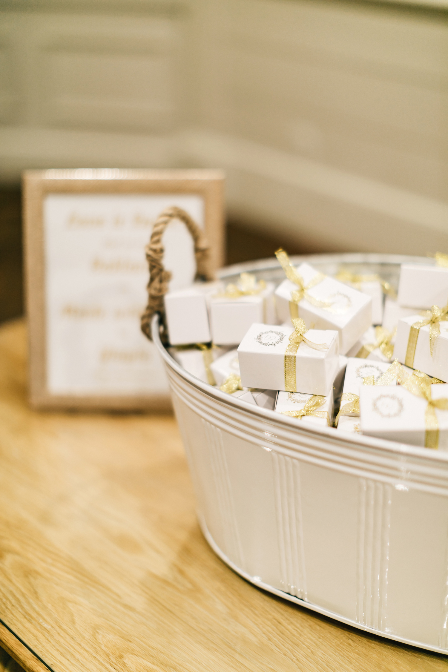 wedding favors boxed and tied with gold ribbon