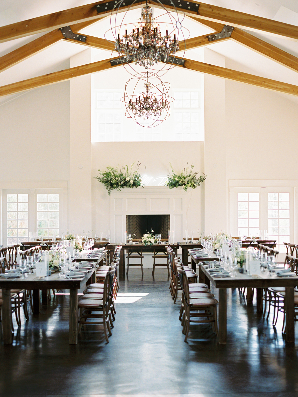 long farm tables and dinnerware set for reception
