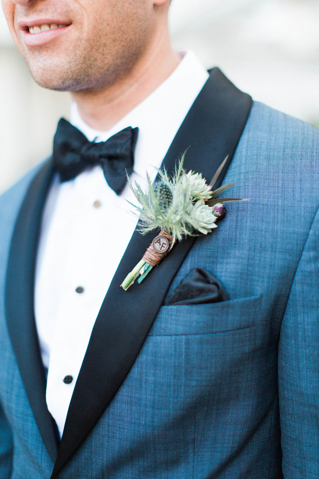 blue thistle boutonniere with World War II Air Force Pin