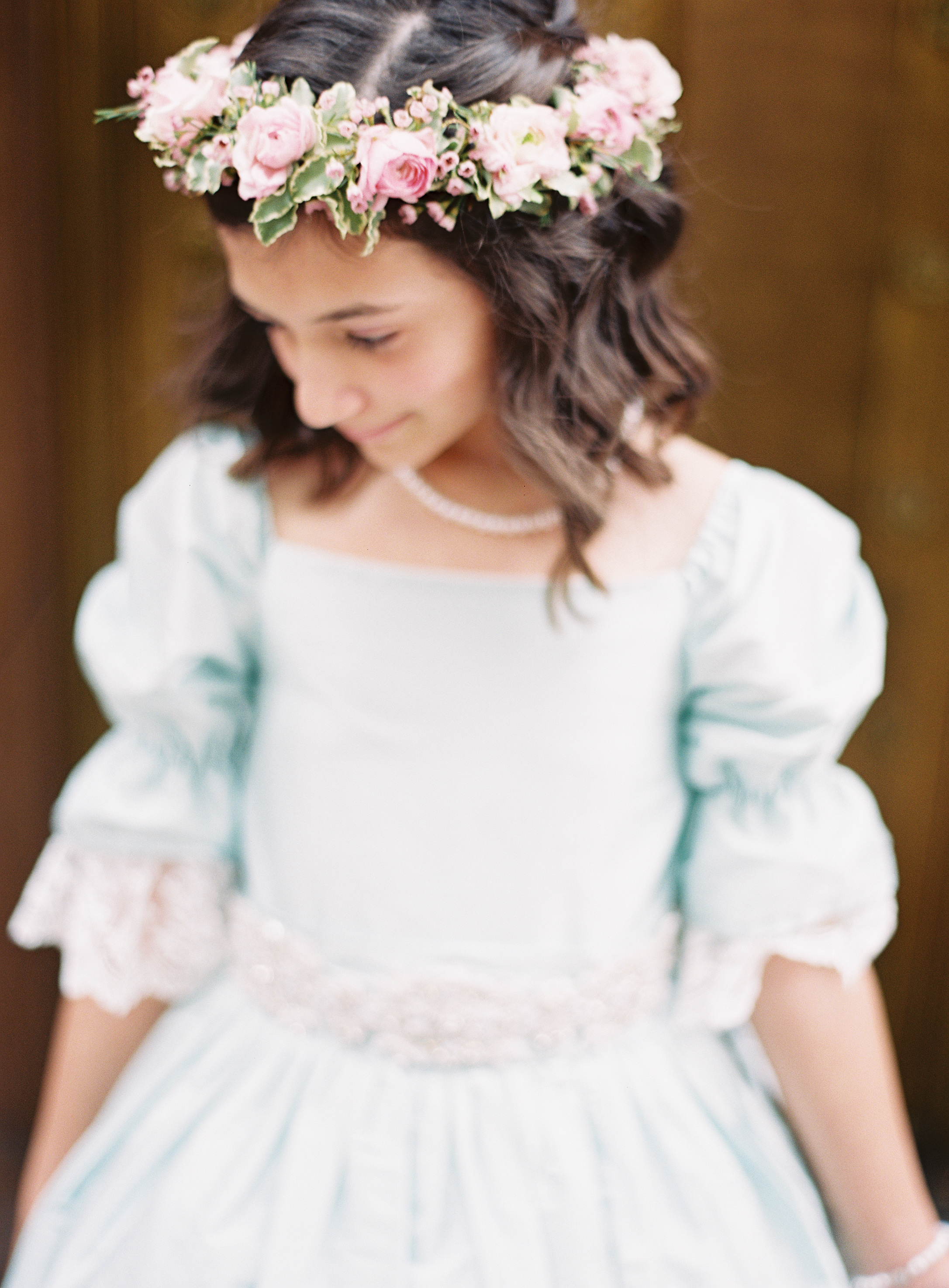 flower girl wearing blue dress and pink flower crown