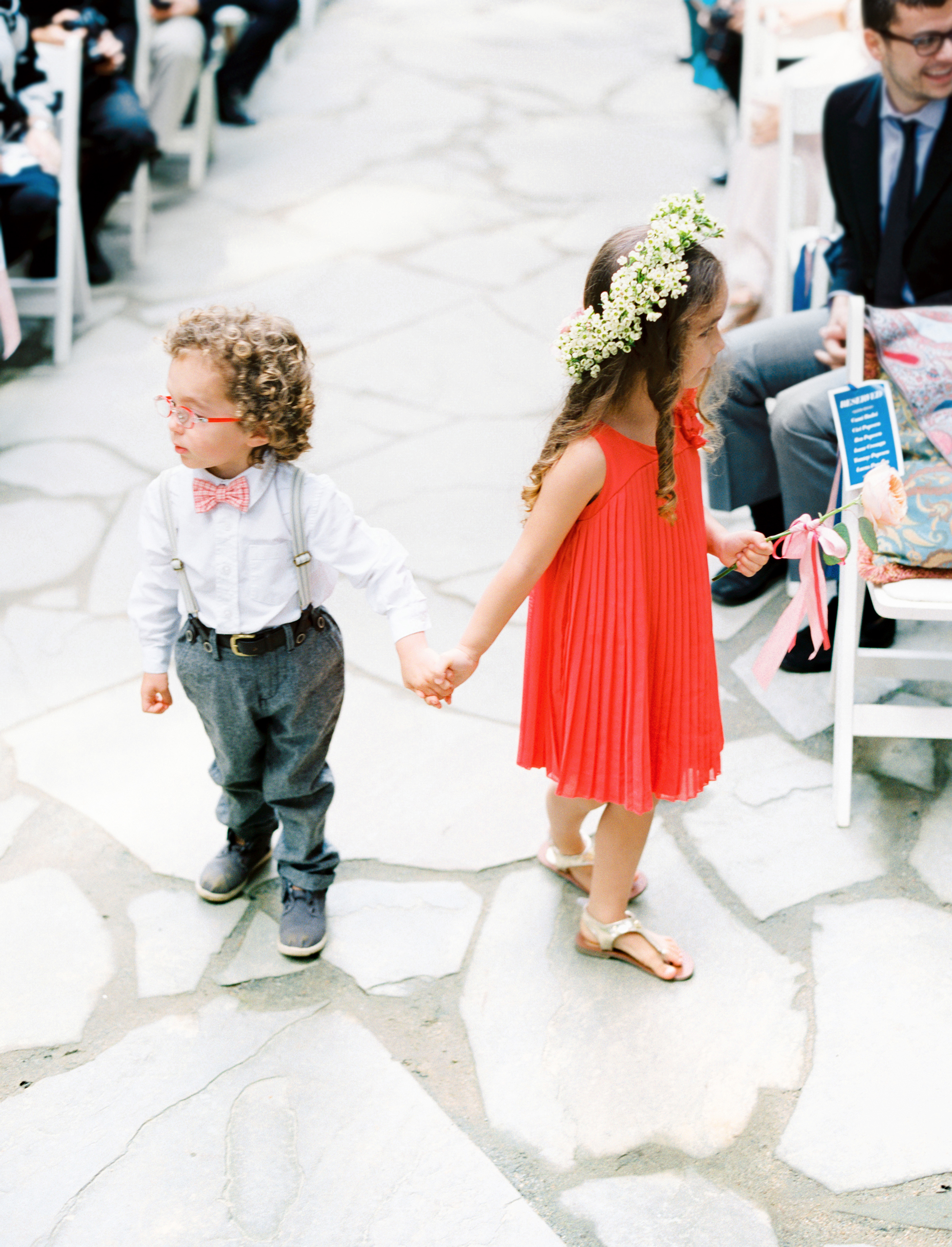 ring bearing and flower girl walking down aisle
