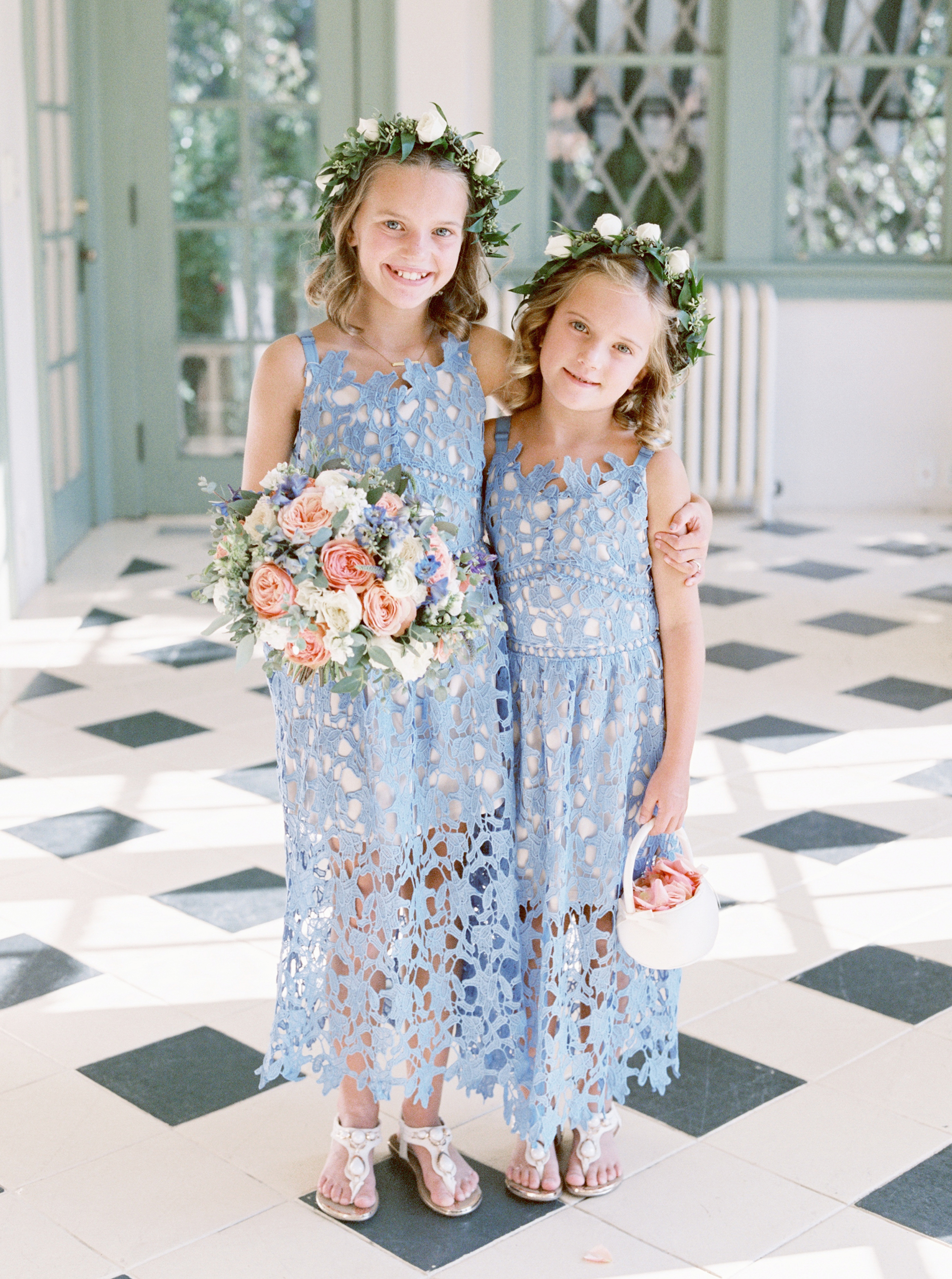 two flower girls in blue lace dresses