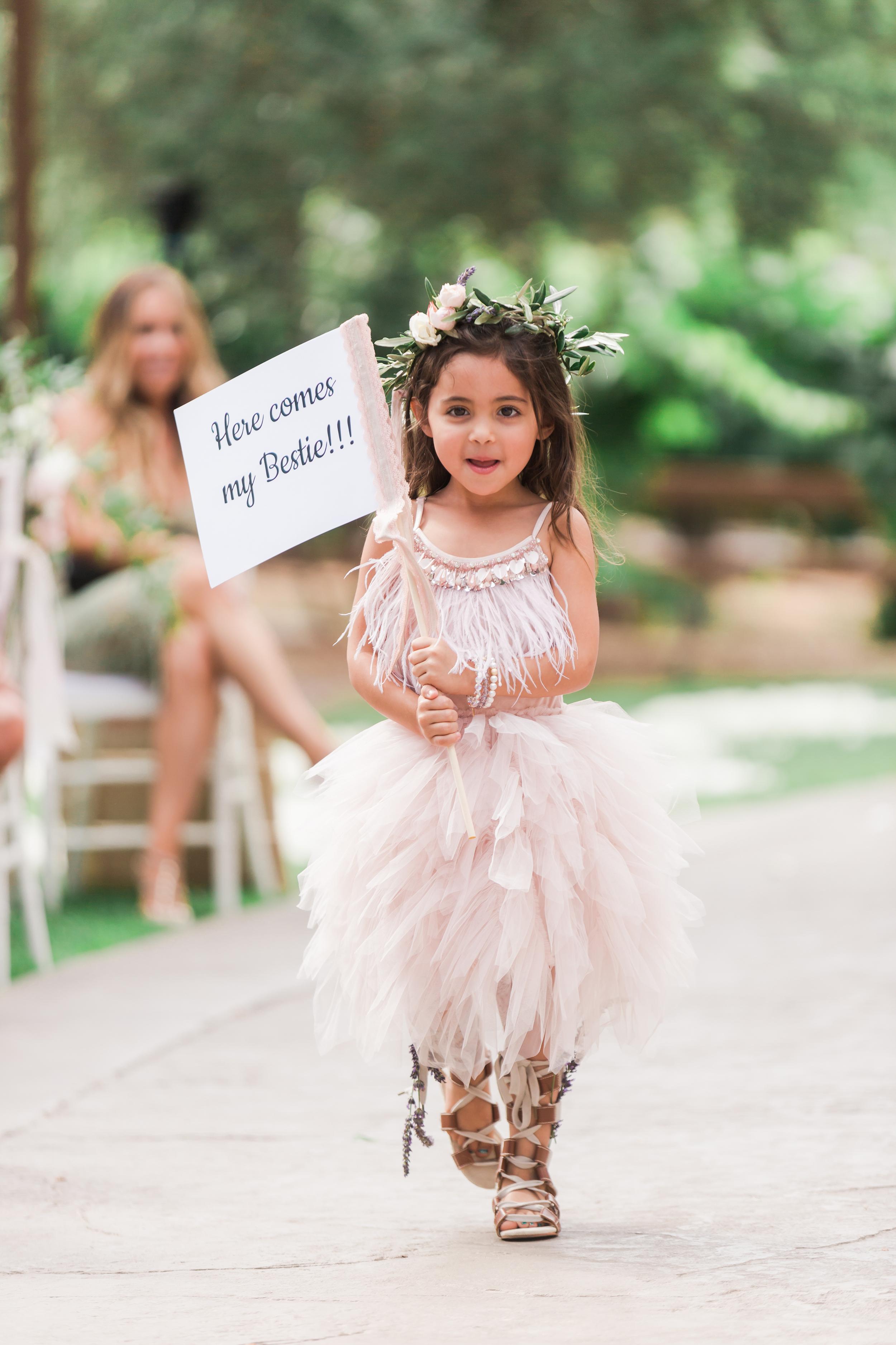 flower girl in pink tulle dress