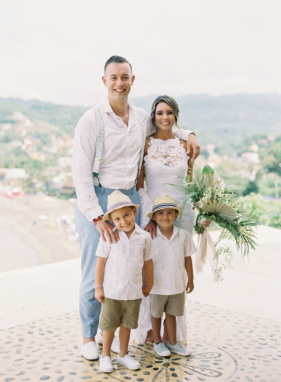 two ring bearers in white button downs and shorts