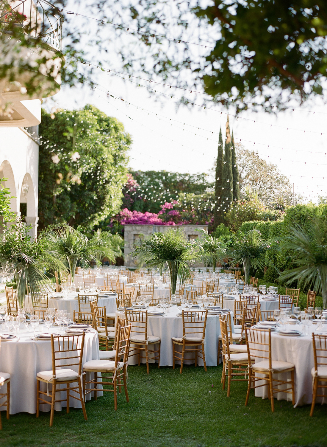 round rehearsal dinner tables in courtyard