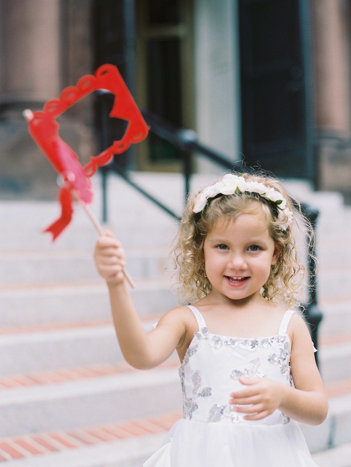 young girl with red flag for recessional