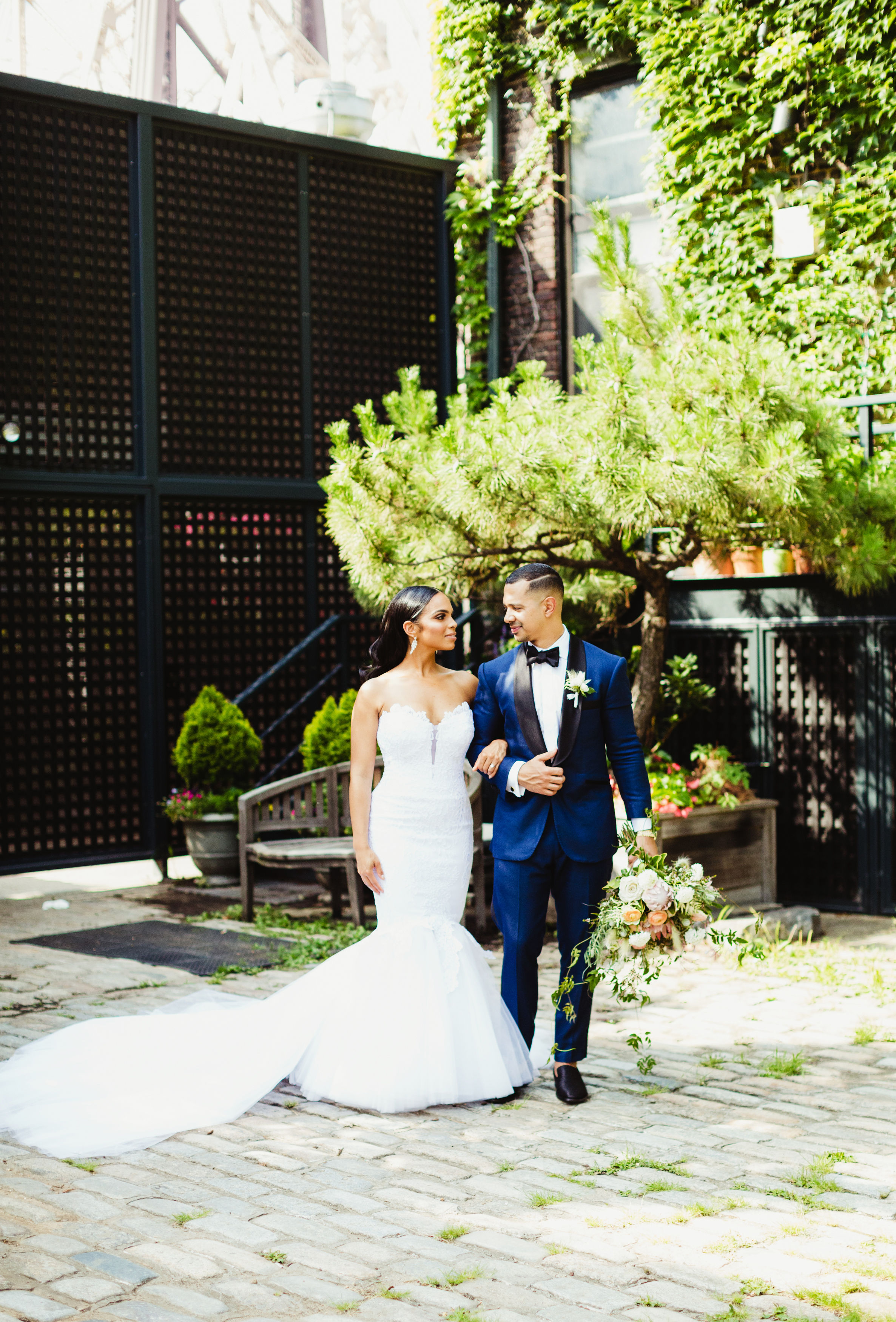 bride and groom walking arm in arm