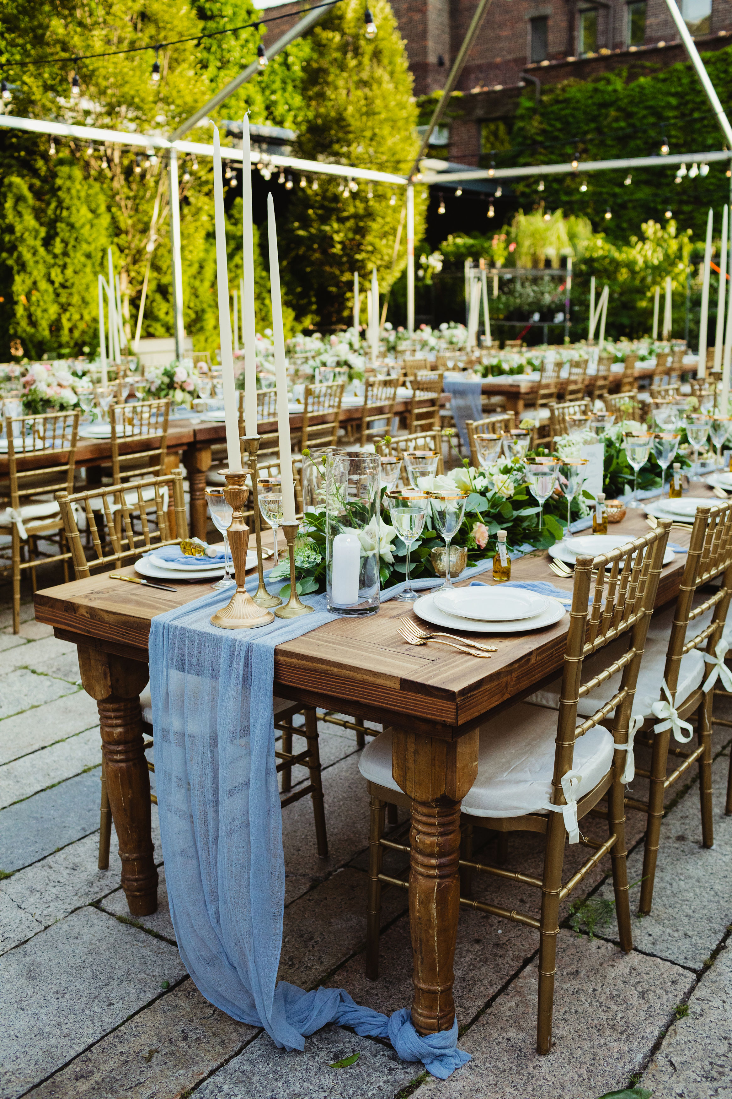 outdoor wedding reception with long wooden guest tables