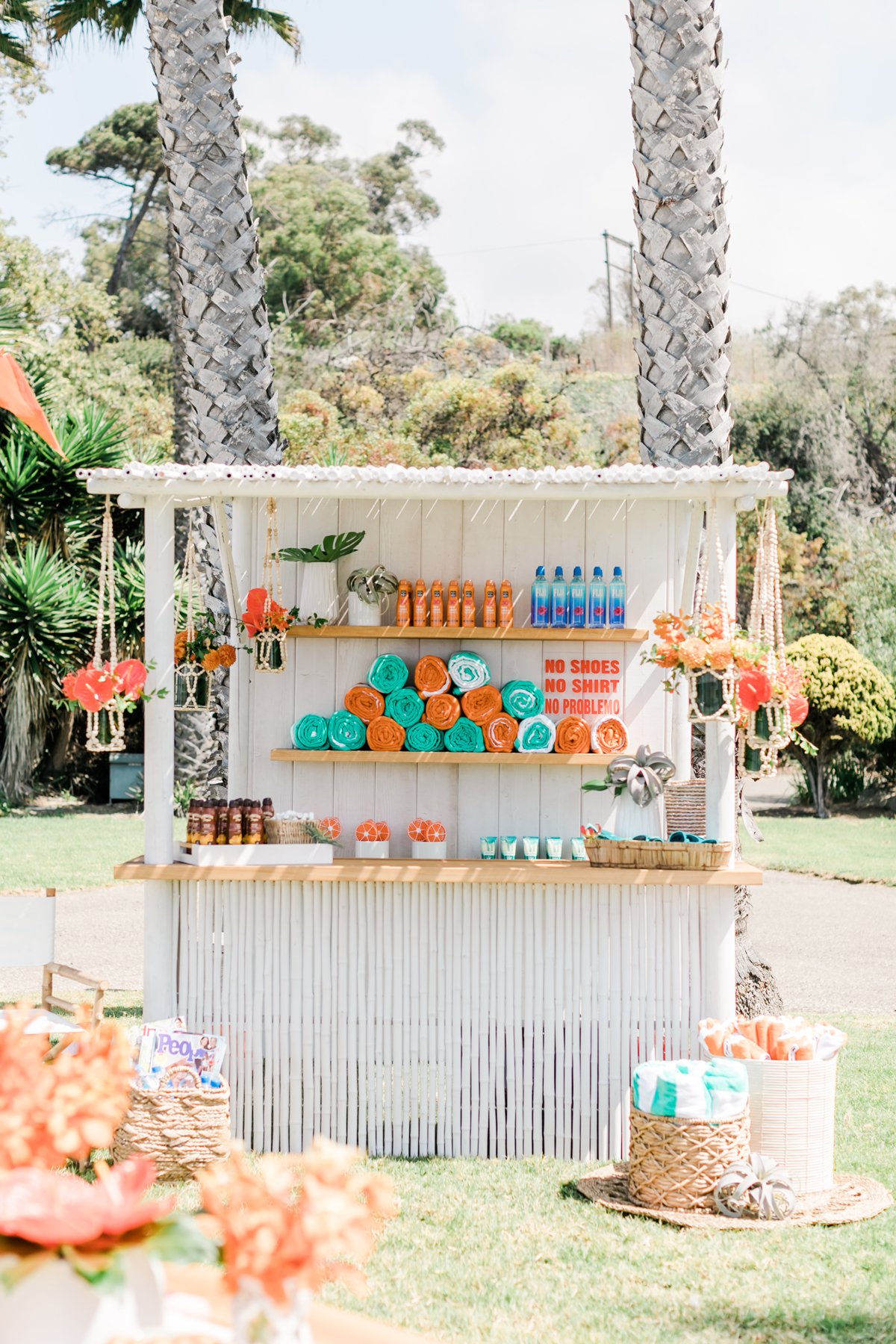 guest welcome bar with orange and turquoise party supplies