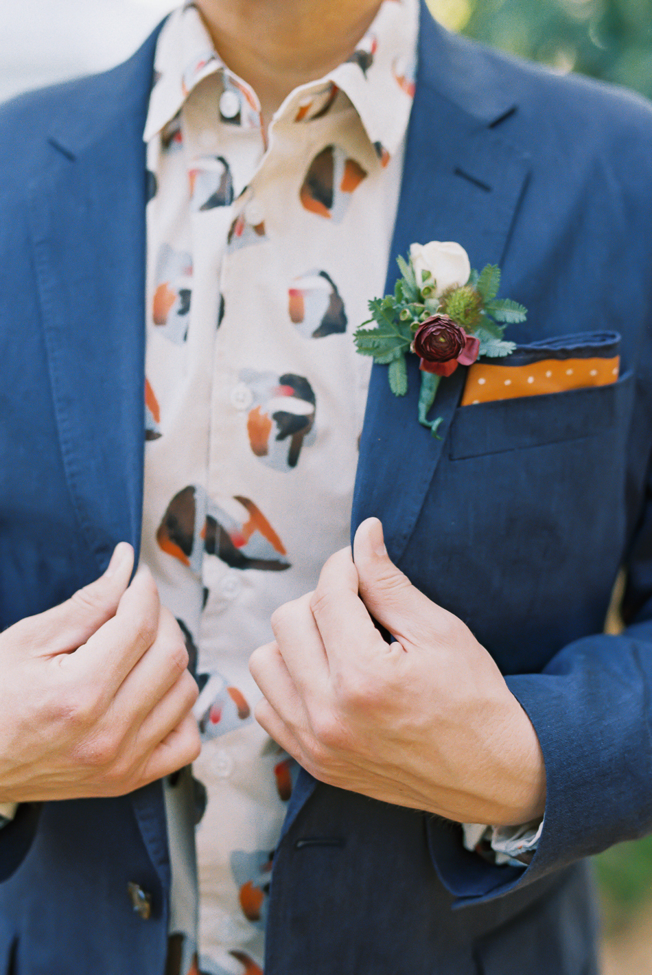 blue and orange contrast suit attire