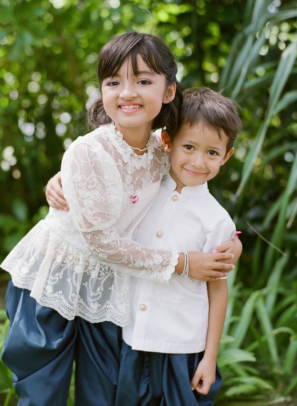 two children wearing traditional Thai outfits