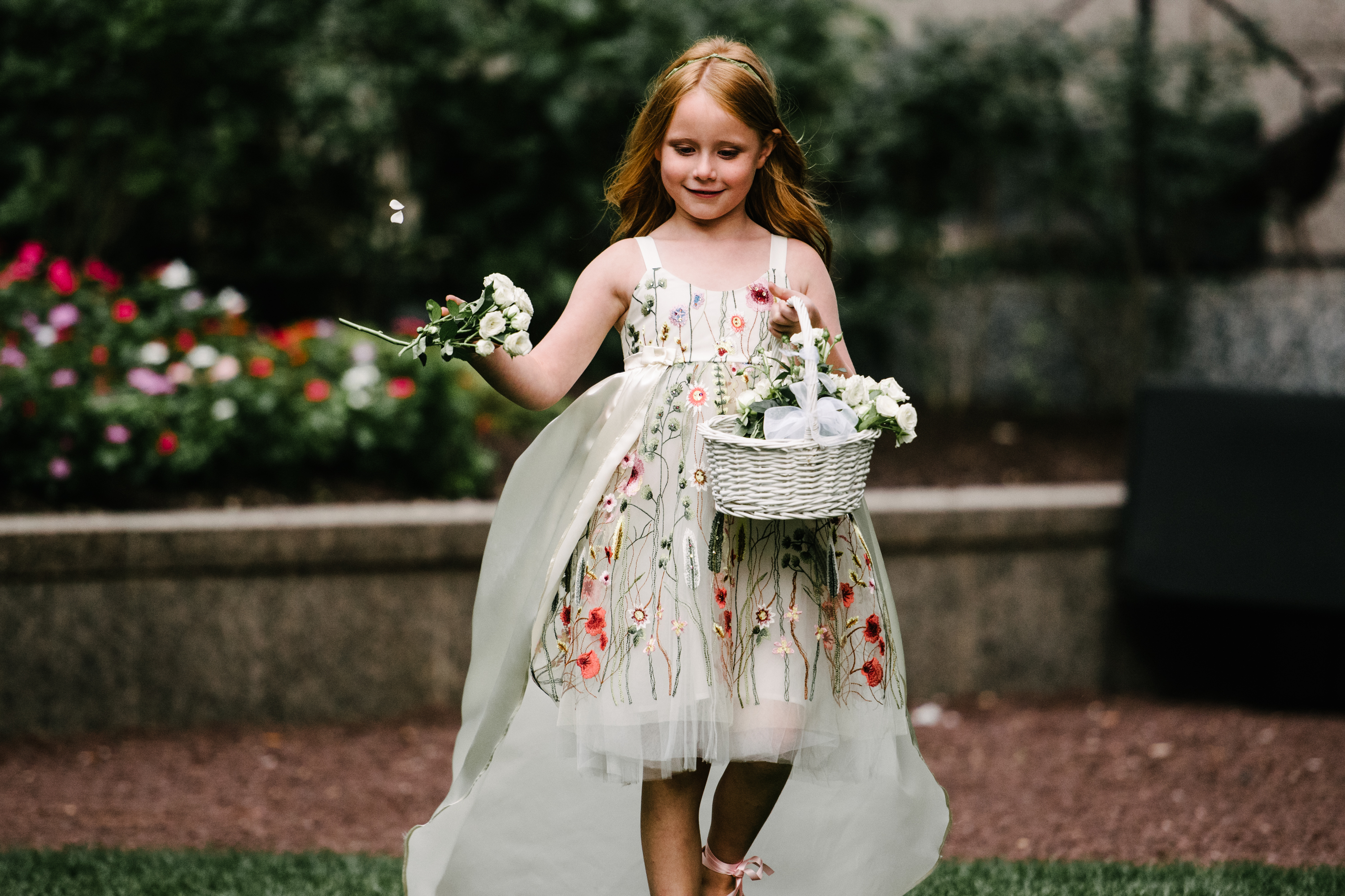 white wicker flower girl basket