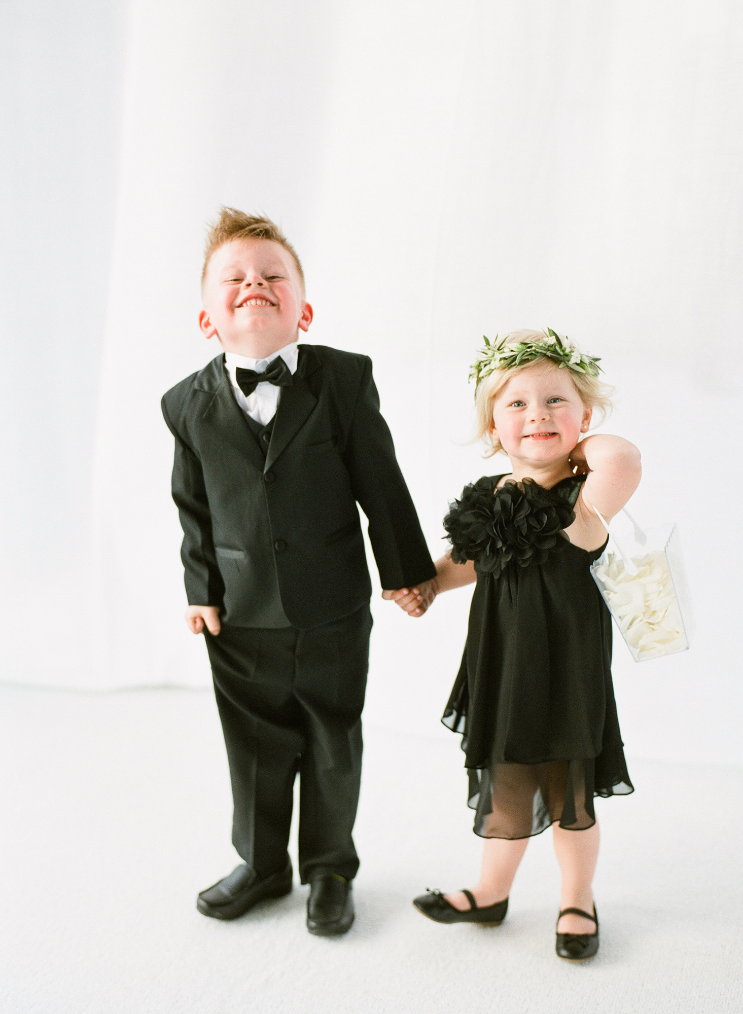 wedding kids holding hands black outfits