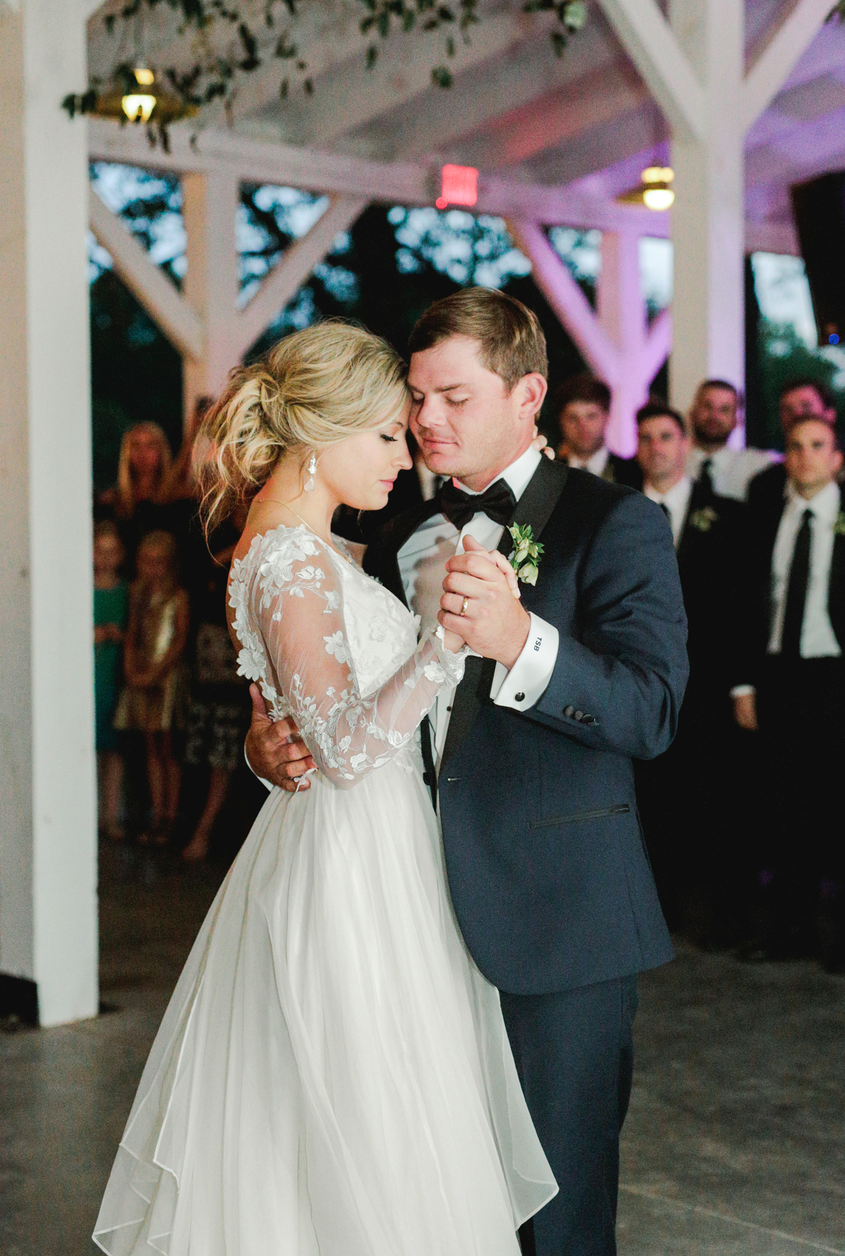 bride and groom sharing first dance in greenhouse venue
