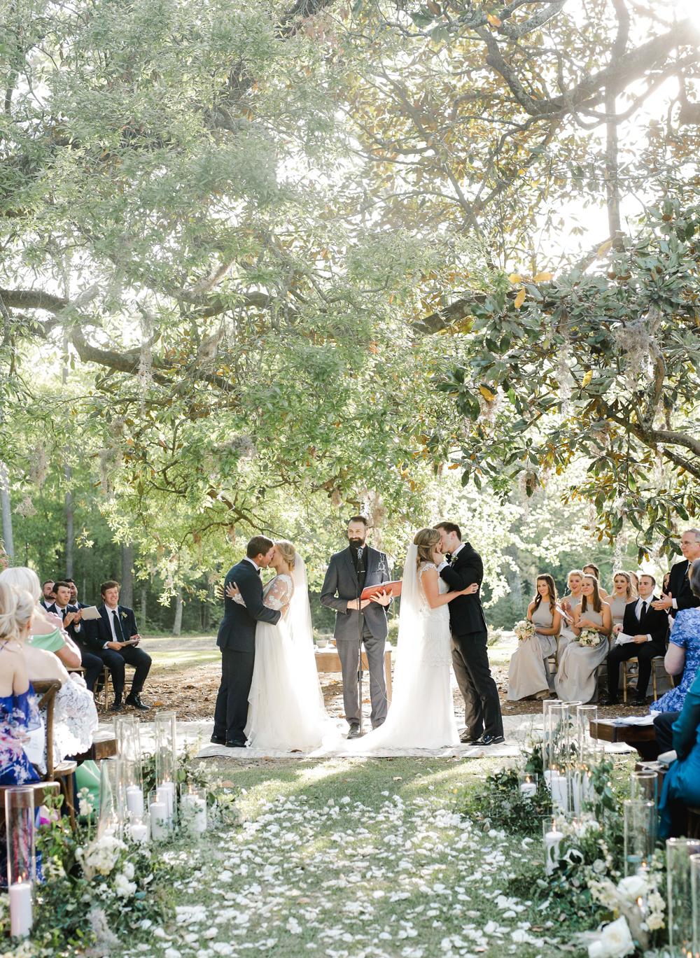 double wedding ceremony couples kissing