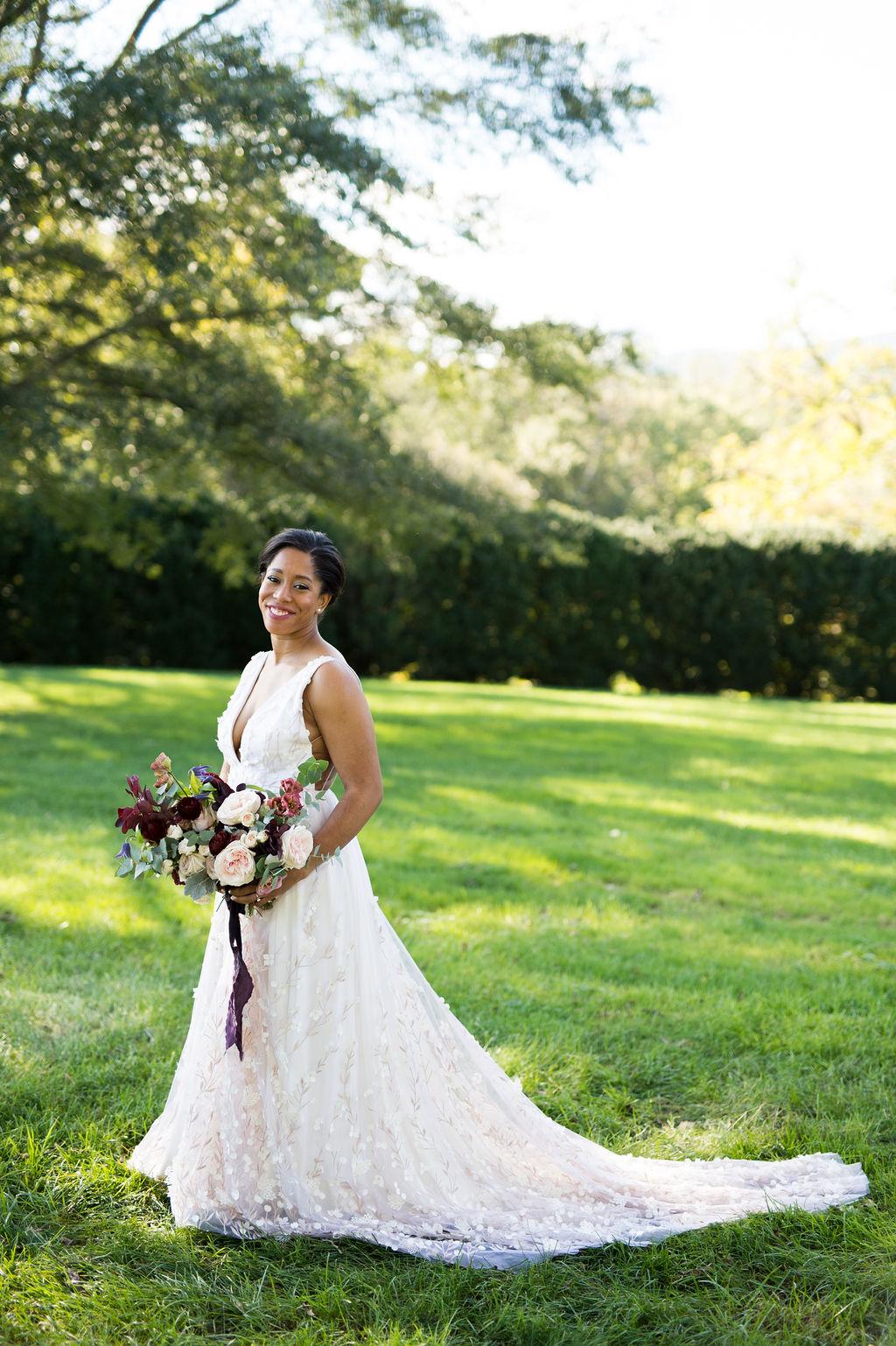 kara taylor wedding bride posing with bouquet