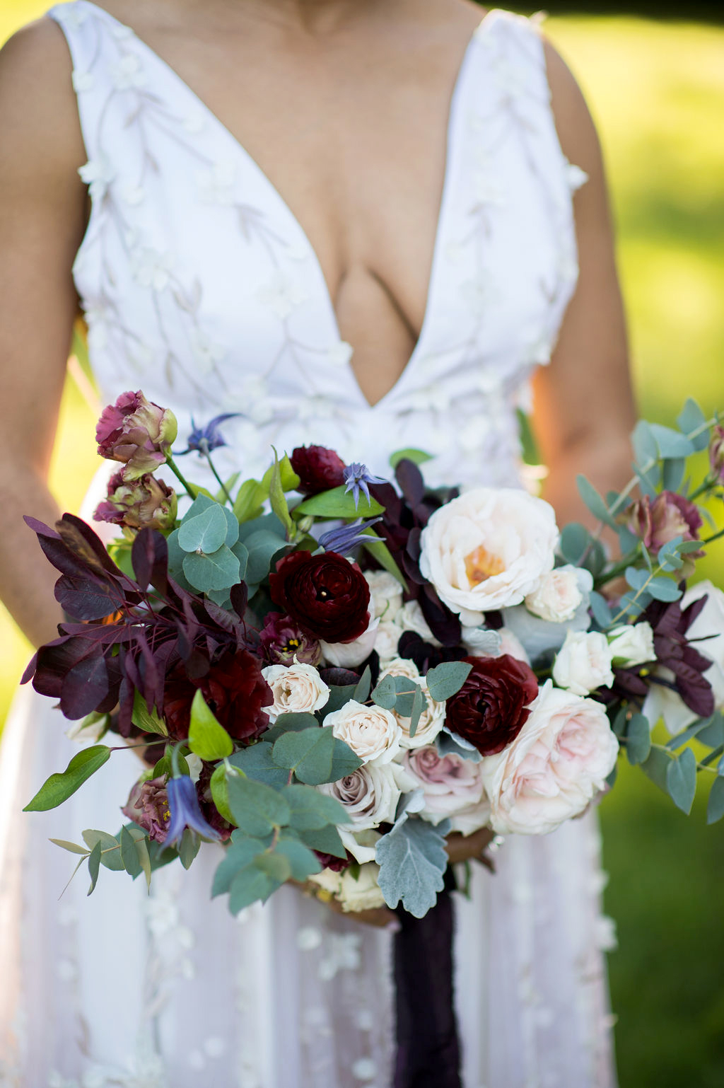 pale blush and deep eggplant colored floral bouquet