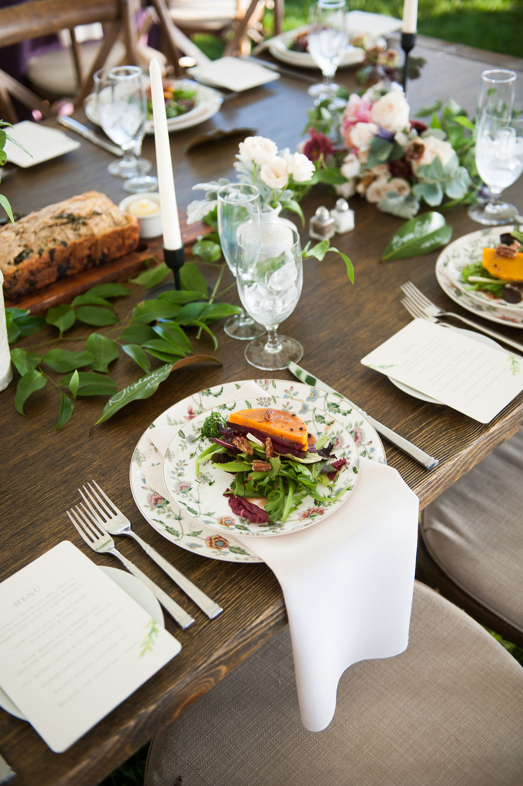 floral plates accented by simple white table linens and floral centerpieces