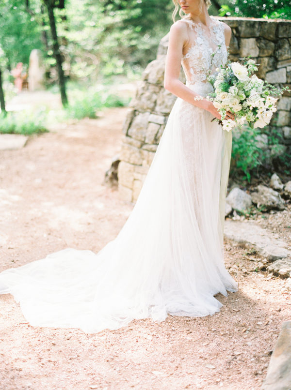 bride with large white dogwood bouquet