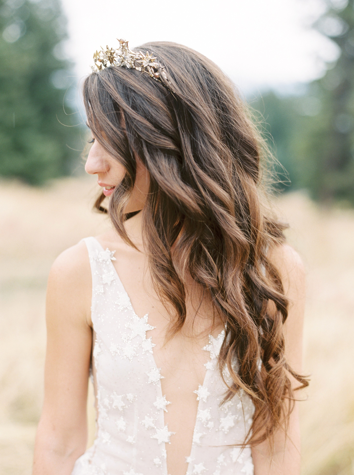 bride wearing gold star tiara
