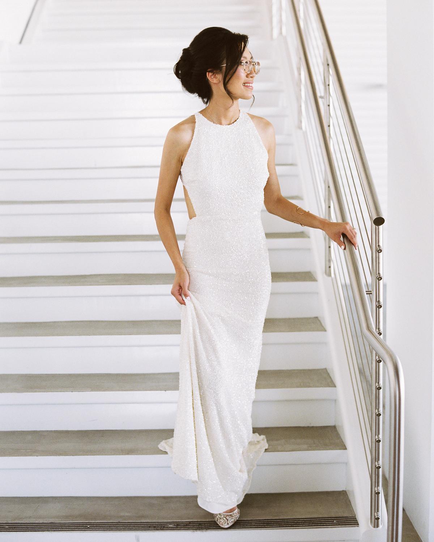 wedding bride walking down staircase in dress