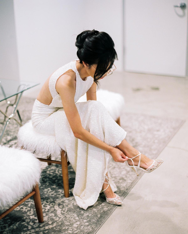 wedding bride getting ready putting on shoe