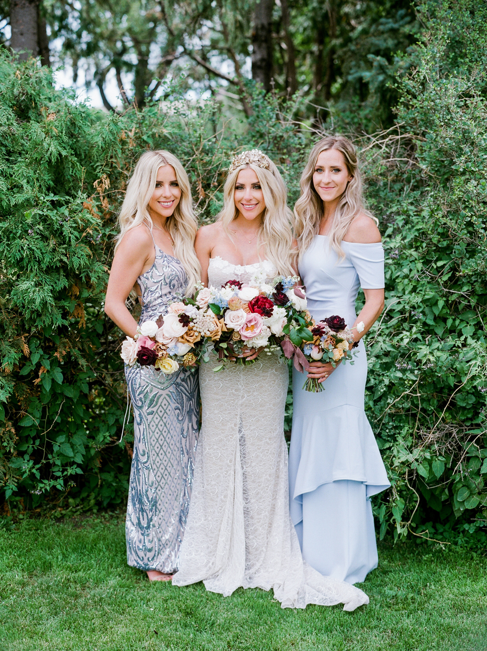 bride standing with her two sisters