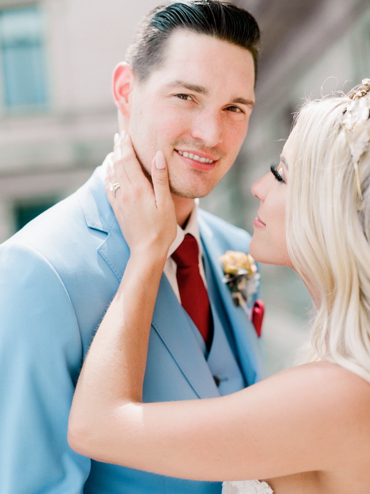 bride caressing grooms face