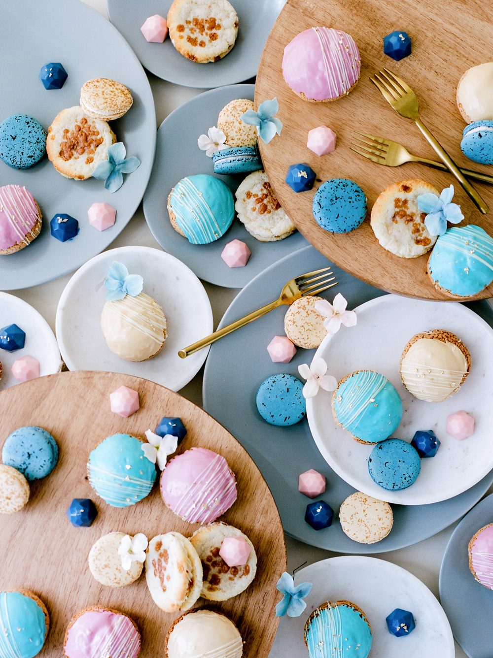 blue and pink macaroons and cream puffs