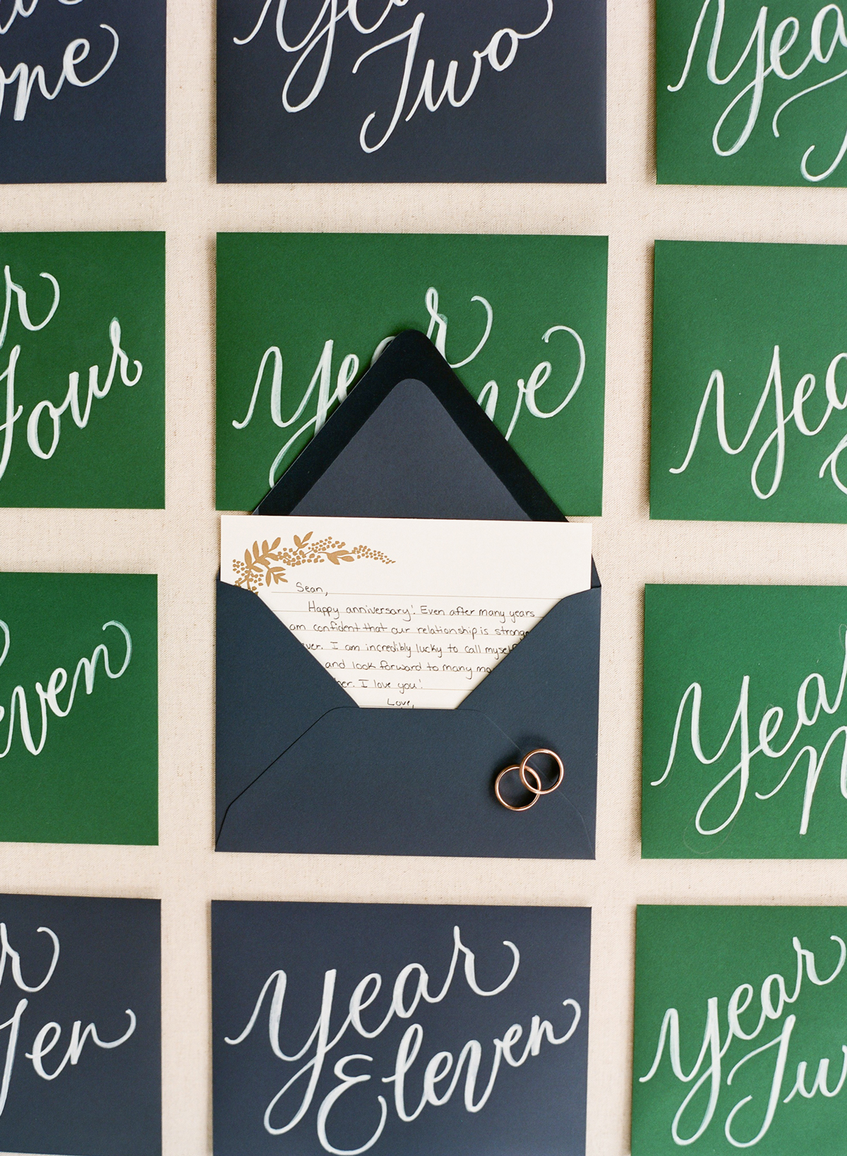 black and green envelope anniversary notes