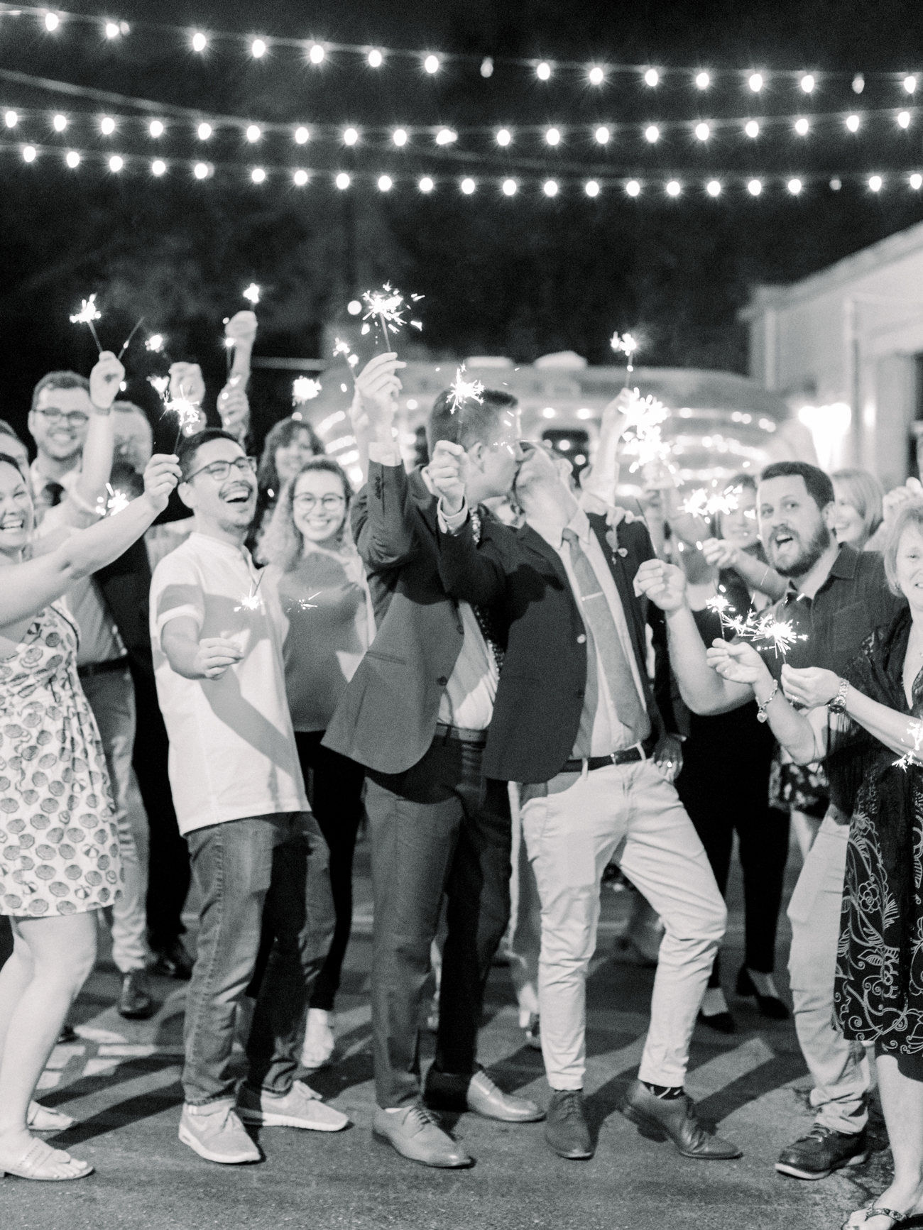 grooms and guests celebrate with sparklers
