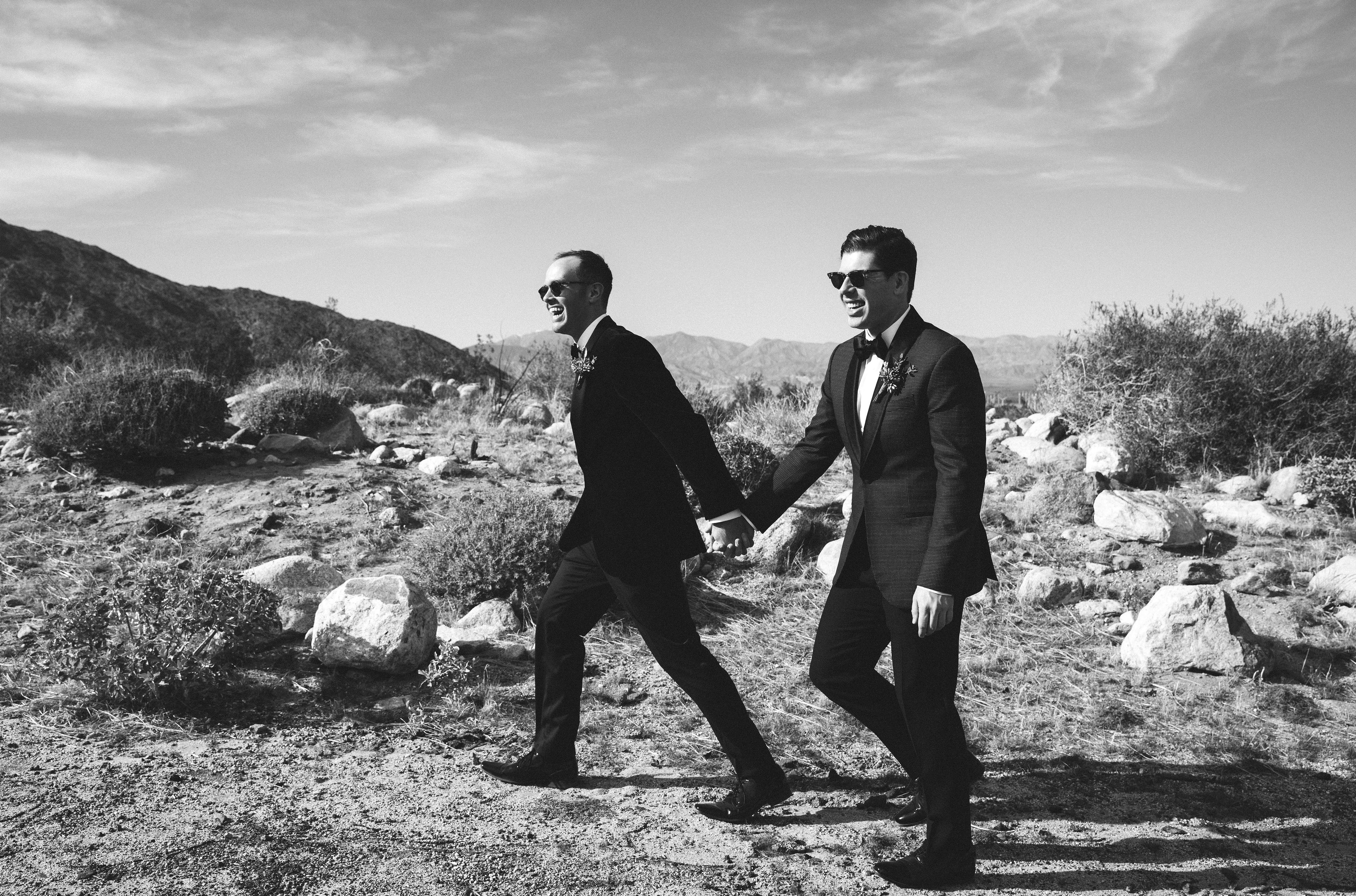 michael thomas wedding grooms holding hands outdoors black and white