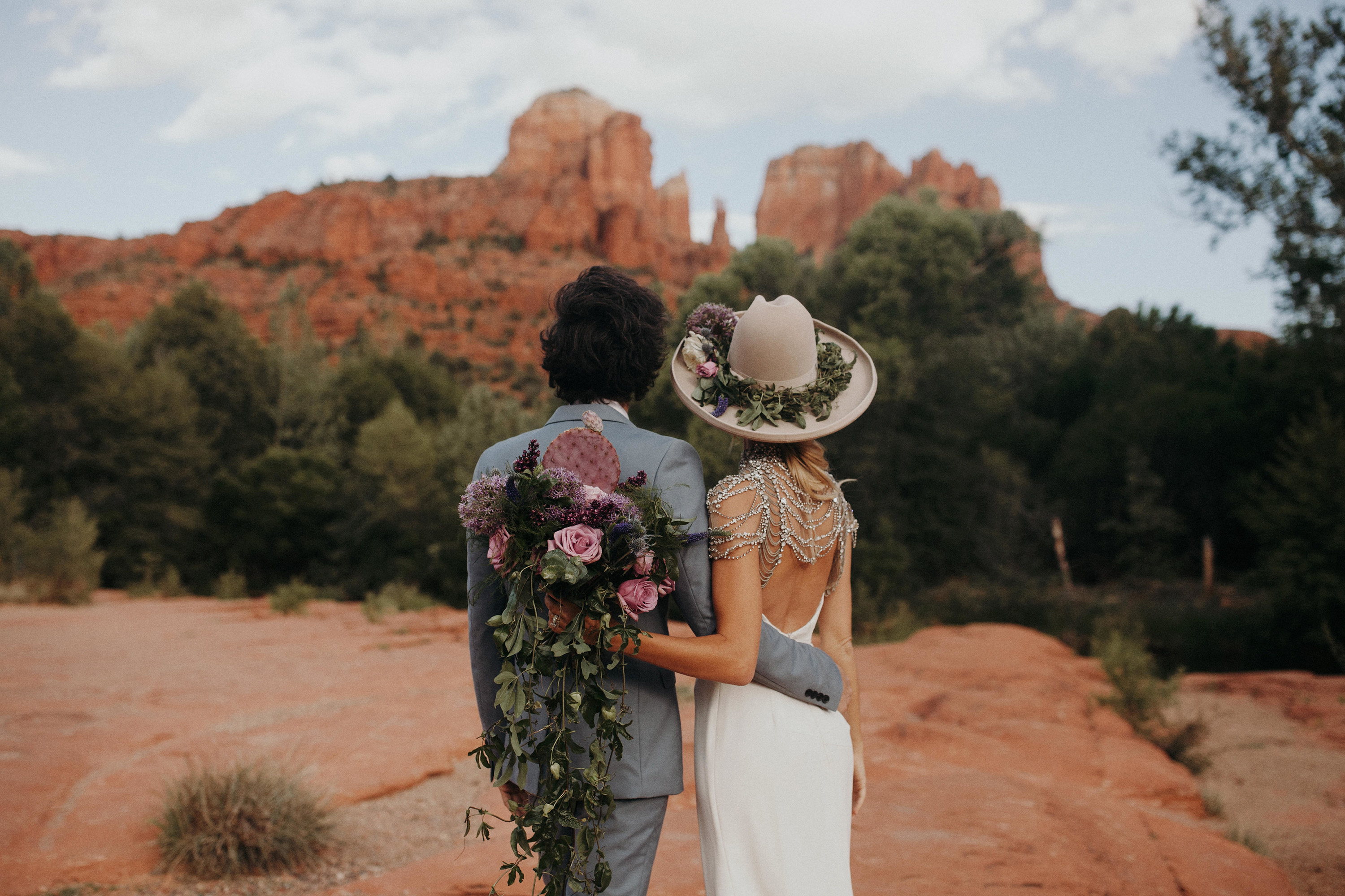 bride wearing hat in the desert