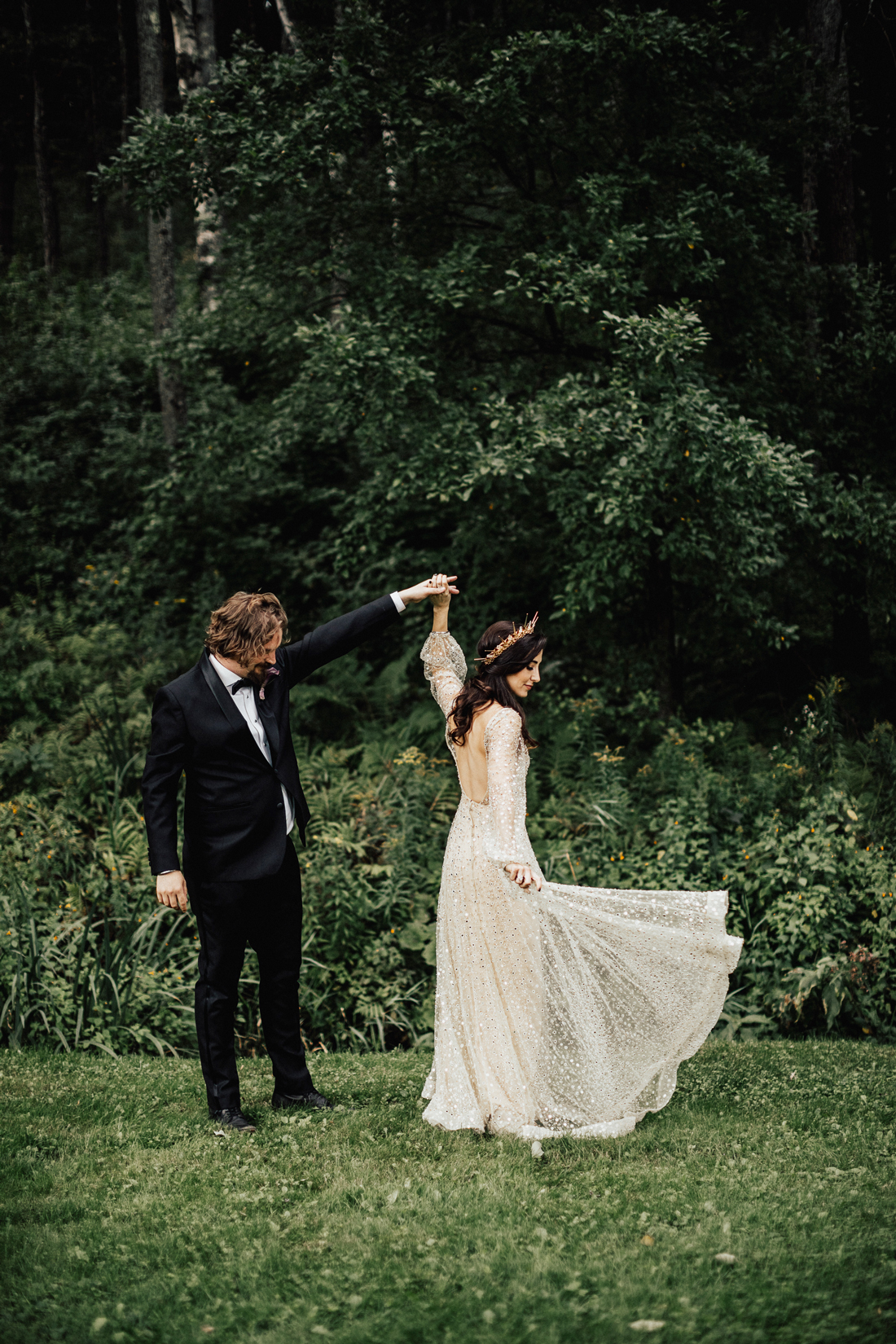 bride and groom share first look in the forest