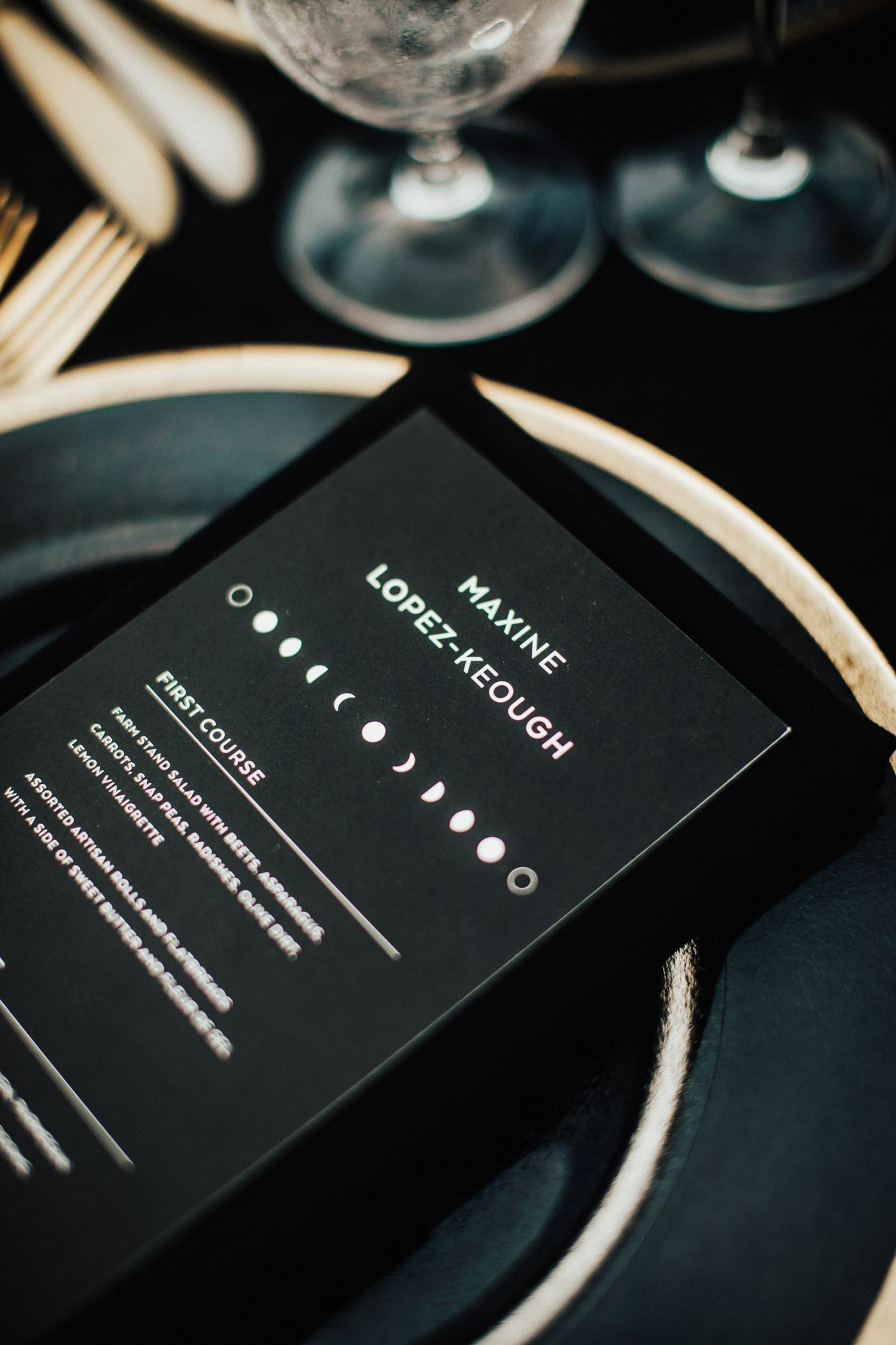 matte black reception menu with moon phase design