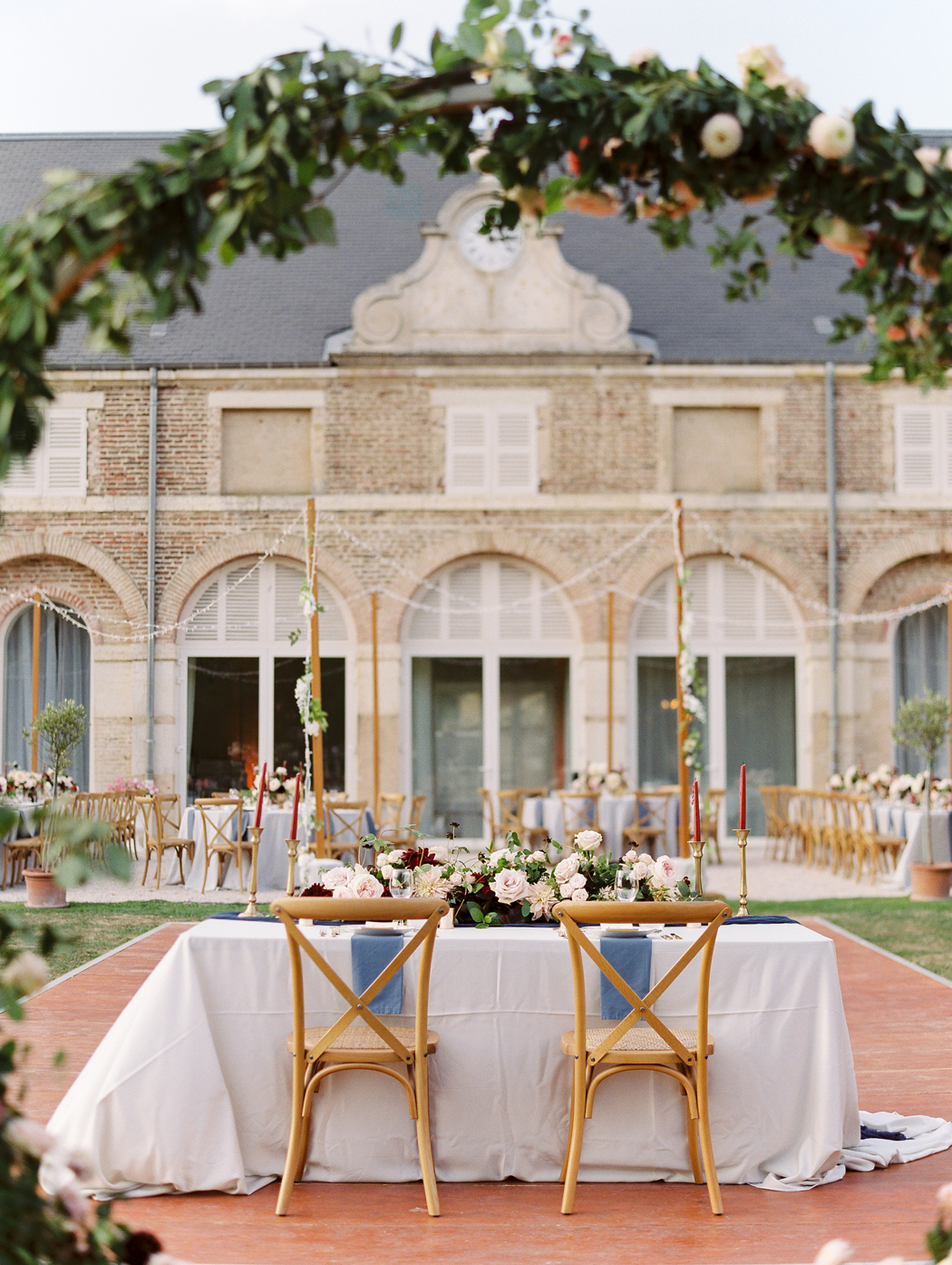 terrace wedding reception with sweetheart table and floral arch