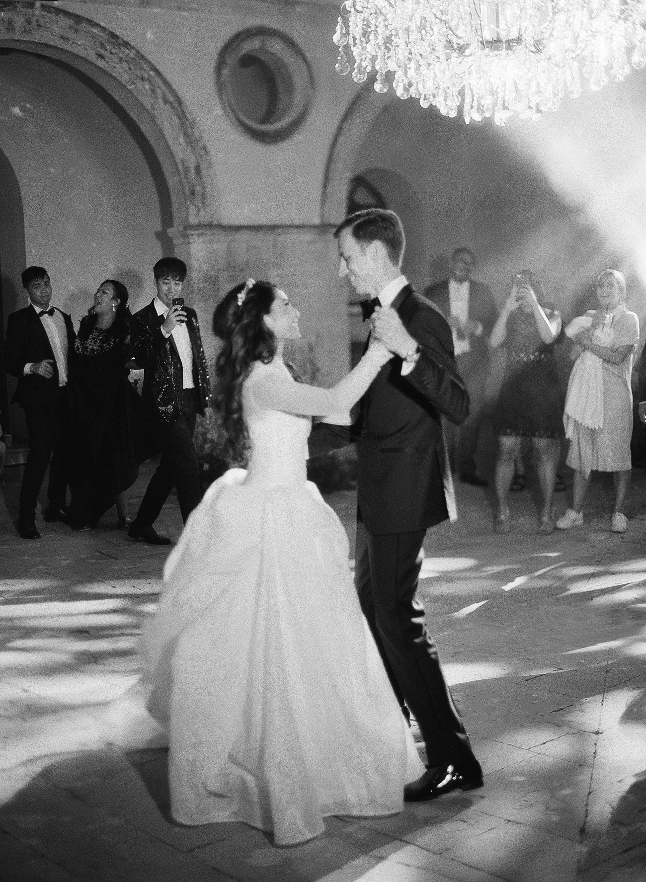 bride and groom share first dance during reception