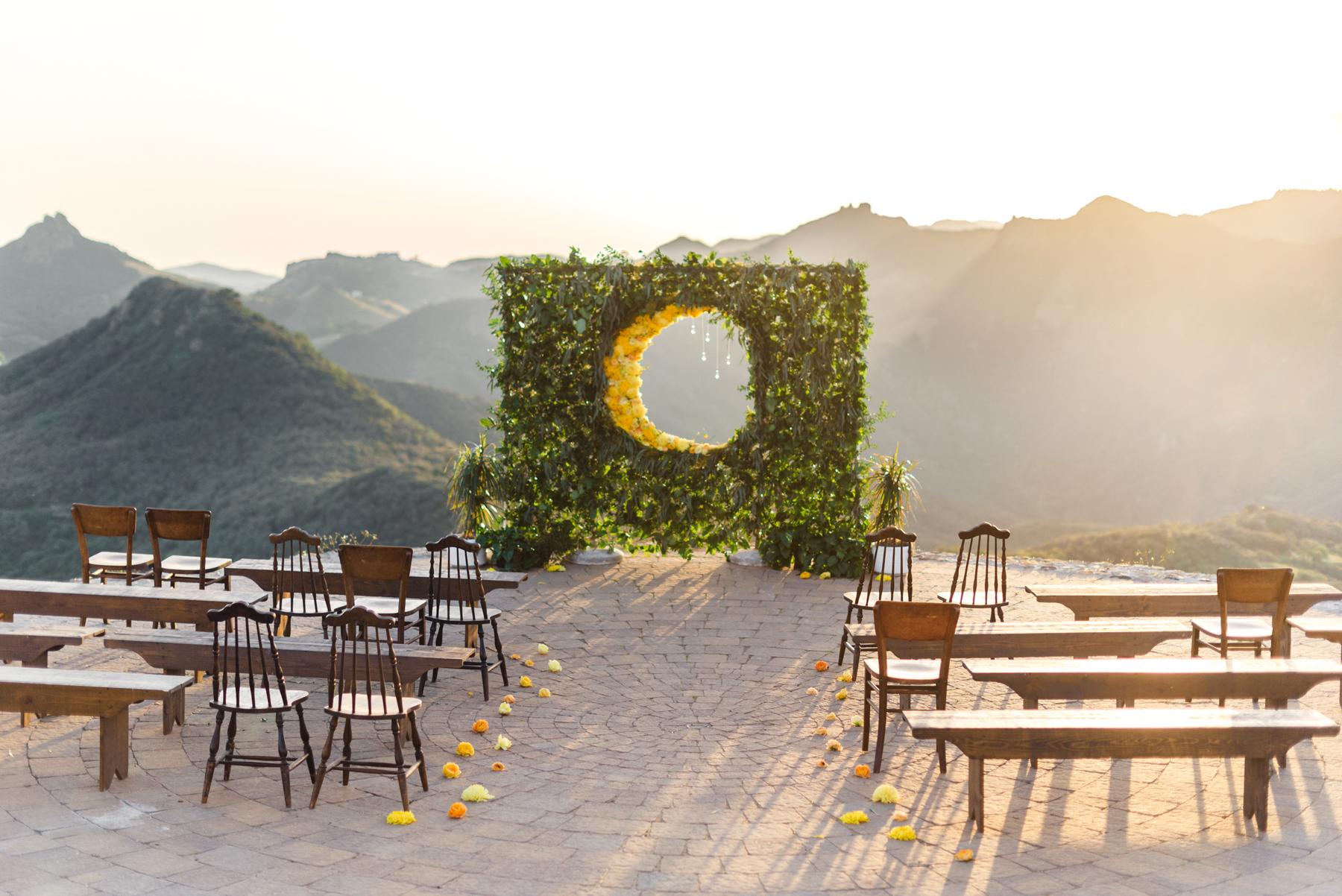 wedding plant wall greenery with circular cutout showcasing mountain range