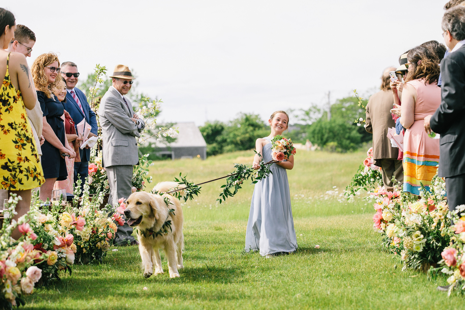 flower girl with dog during wedding processional