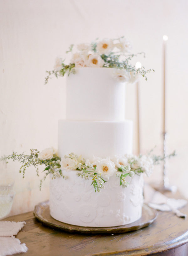 floral accent three tiered white wedding cake