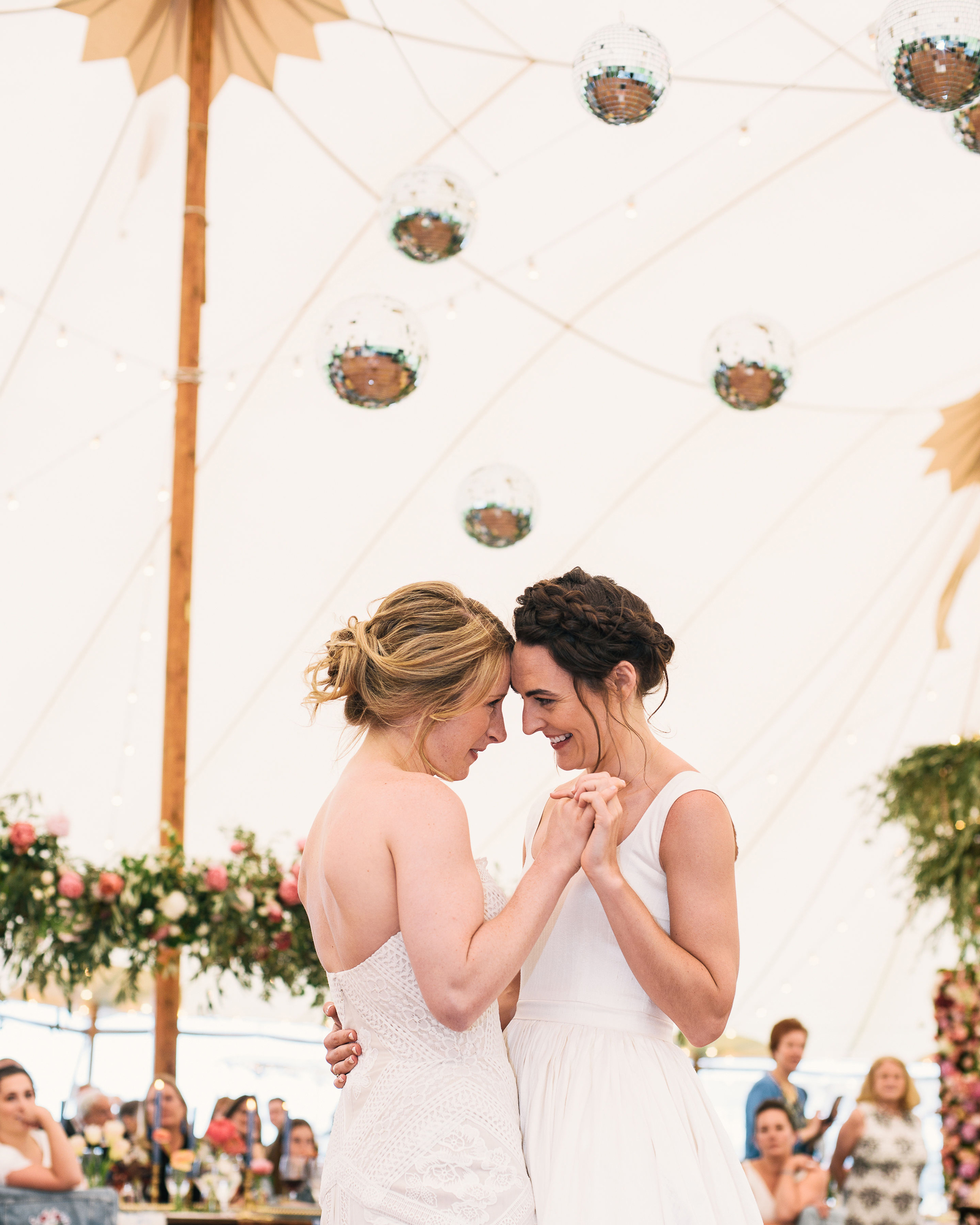 brides share first dance under outdoor tent