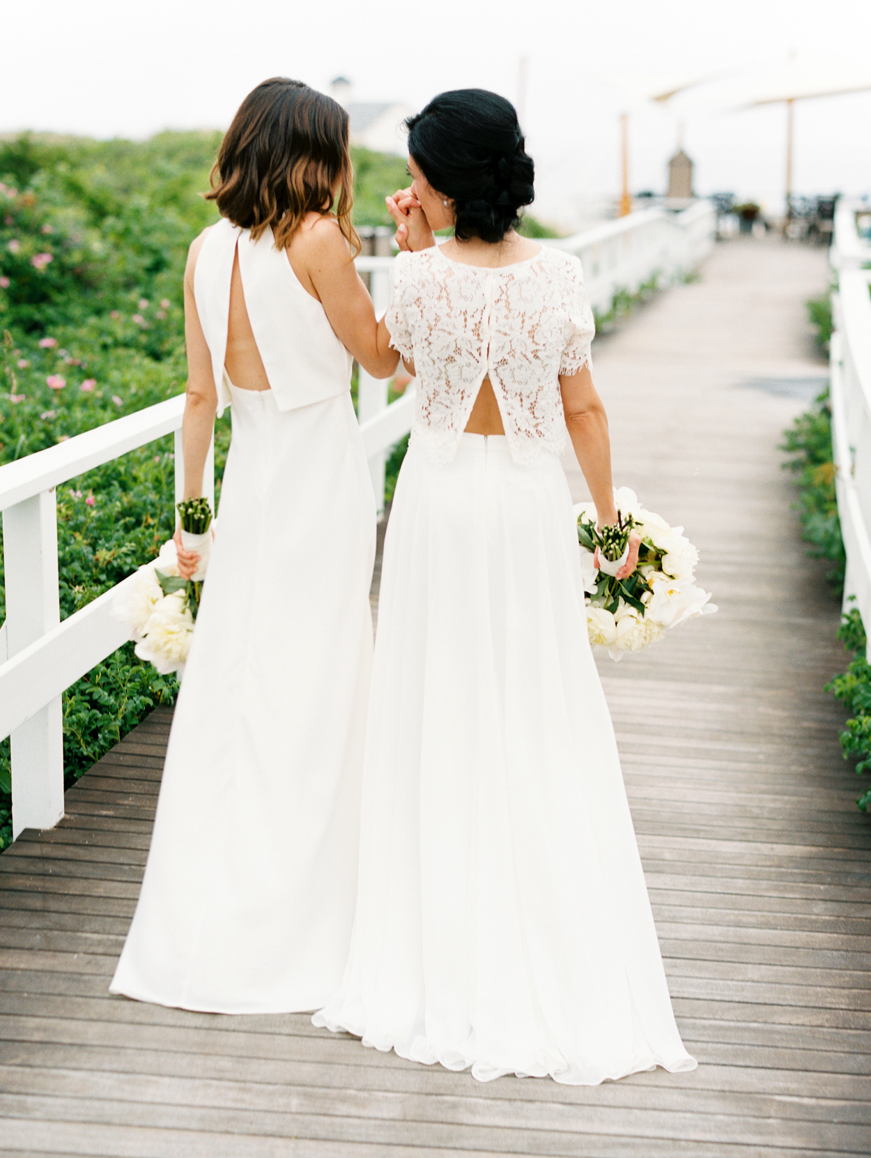 brides wearing ivory wedding dresses with split back tops