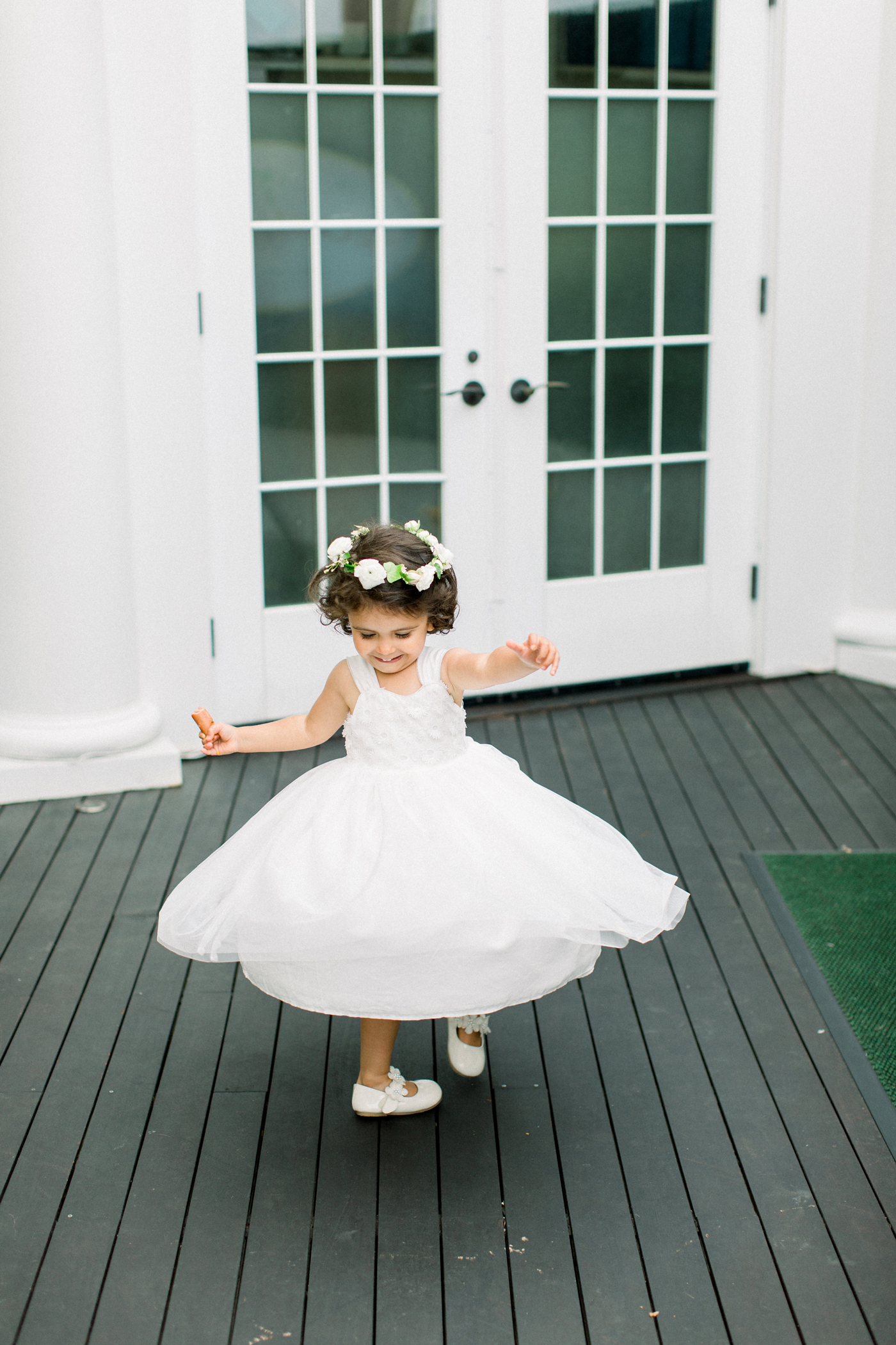 flower girl with white floral crown
