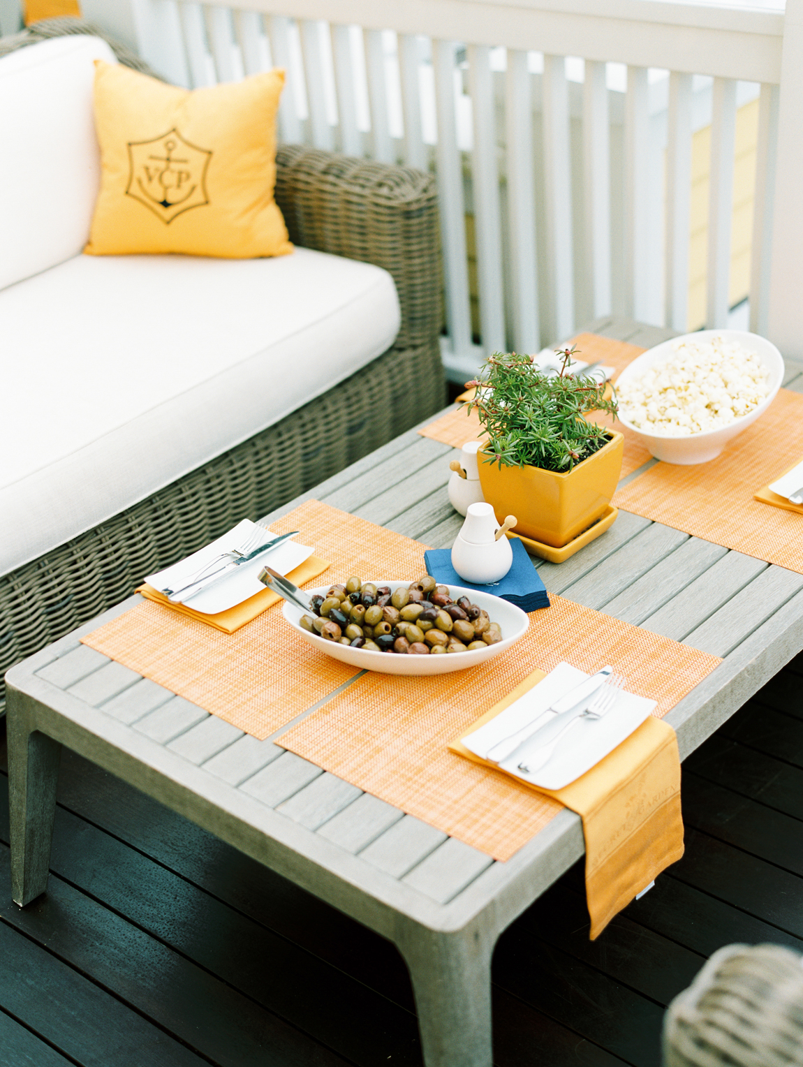 cocktail hour patio furniture with orange accents