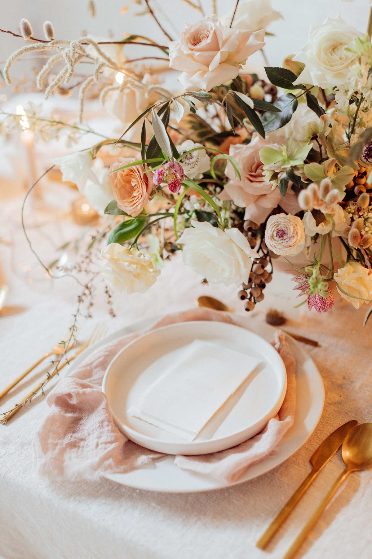 wedding reception napkin folds pink napkin draped beneath plate