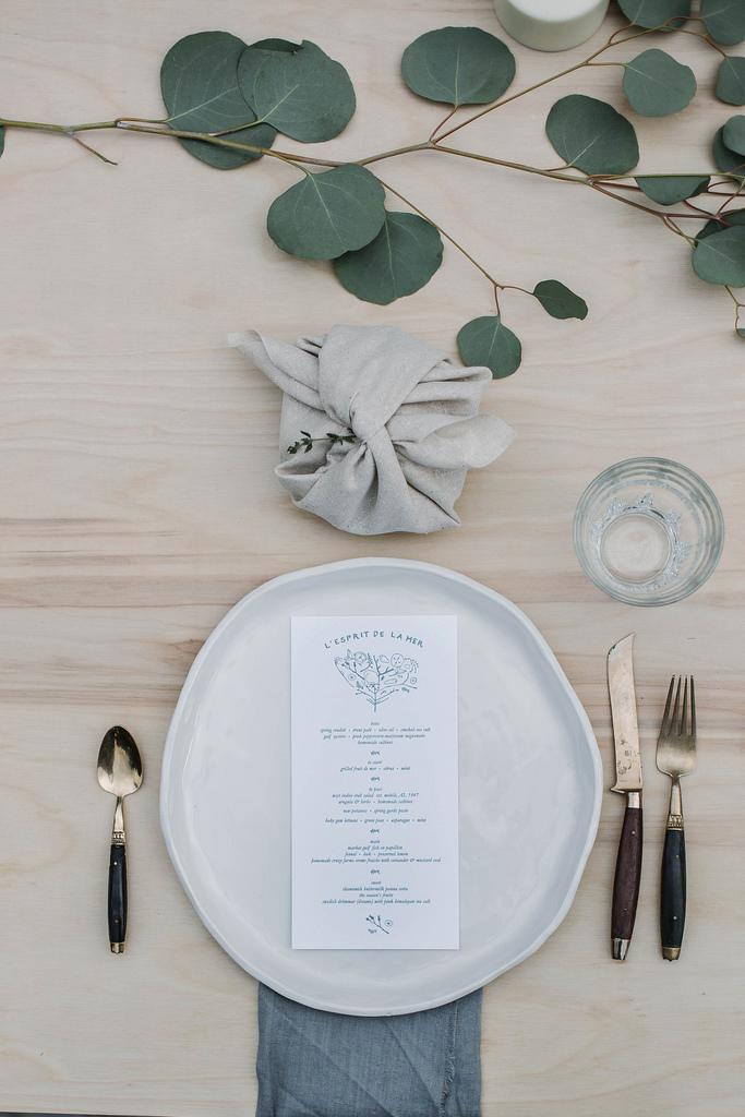 wedding reception napkin folds gray napkin wrapped up above plate