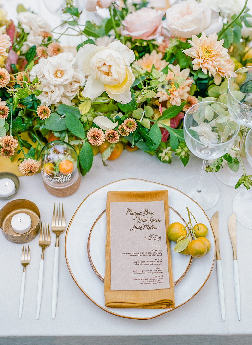 white and gold place settings with citrus floral table accents
