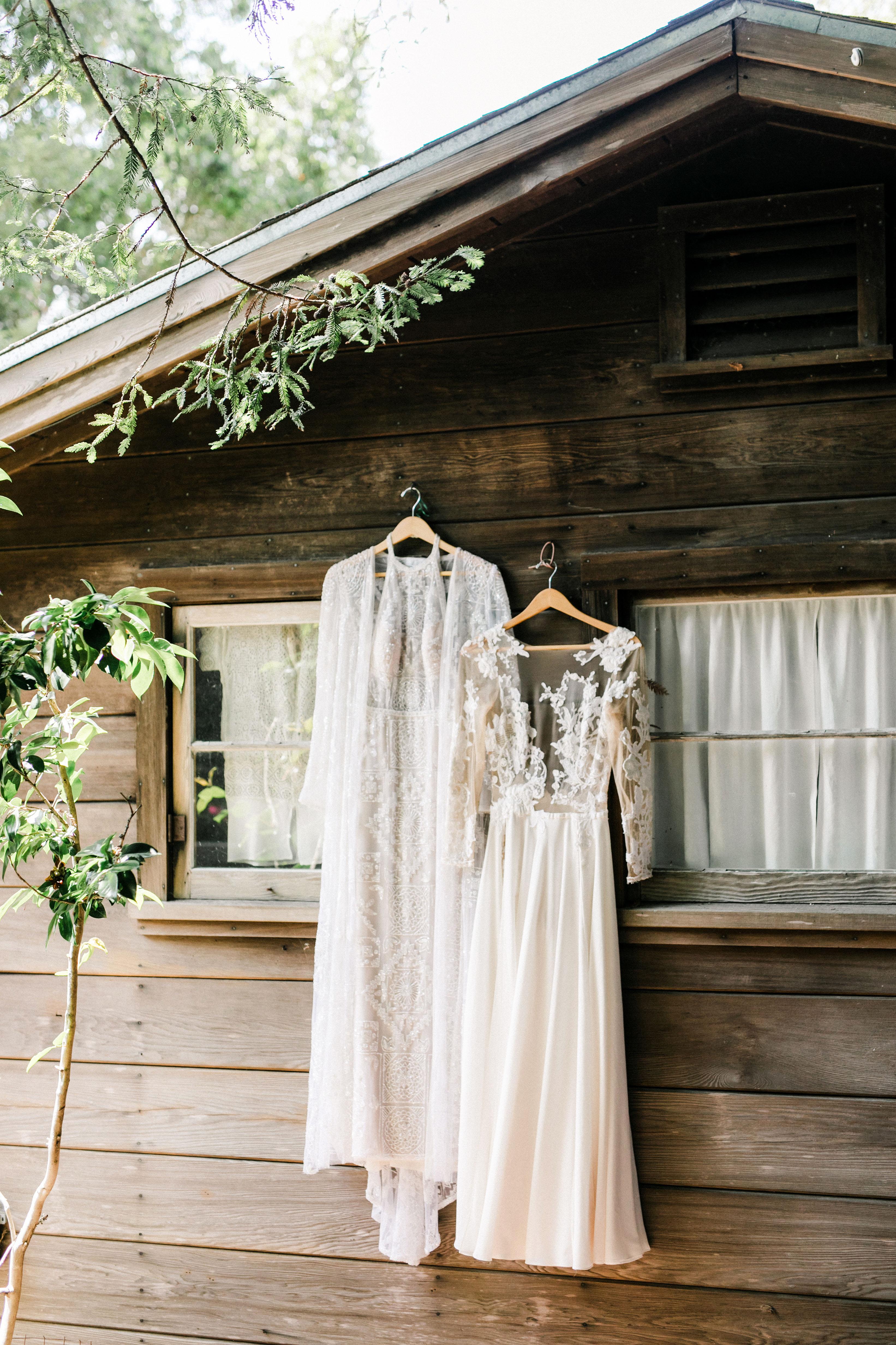 amanda chase wedding dresses hung up on cabin wall
