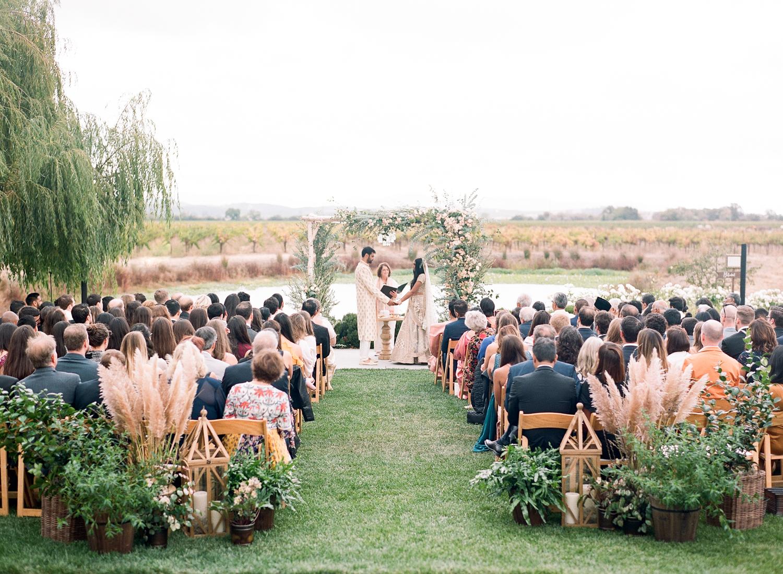 bride and groom exchange vows during outdoor wedding ceremony