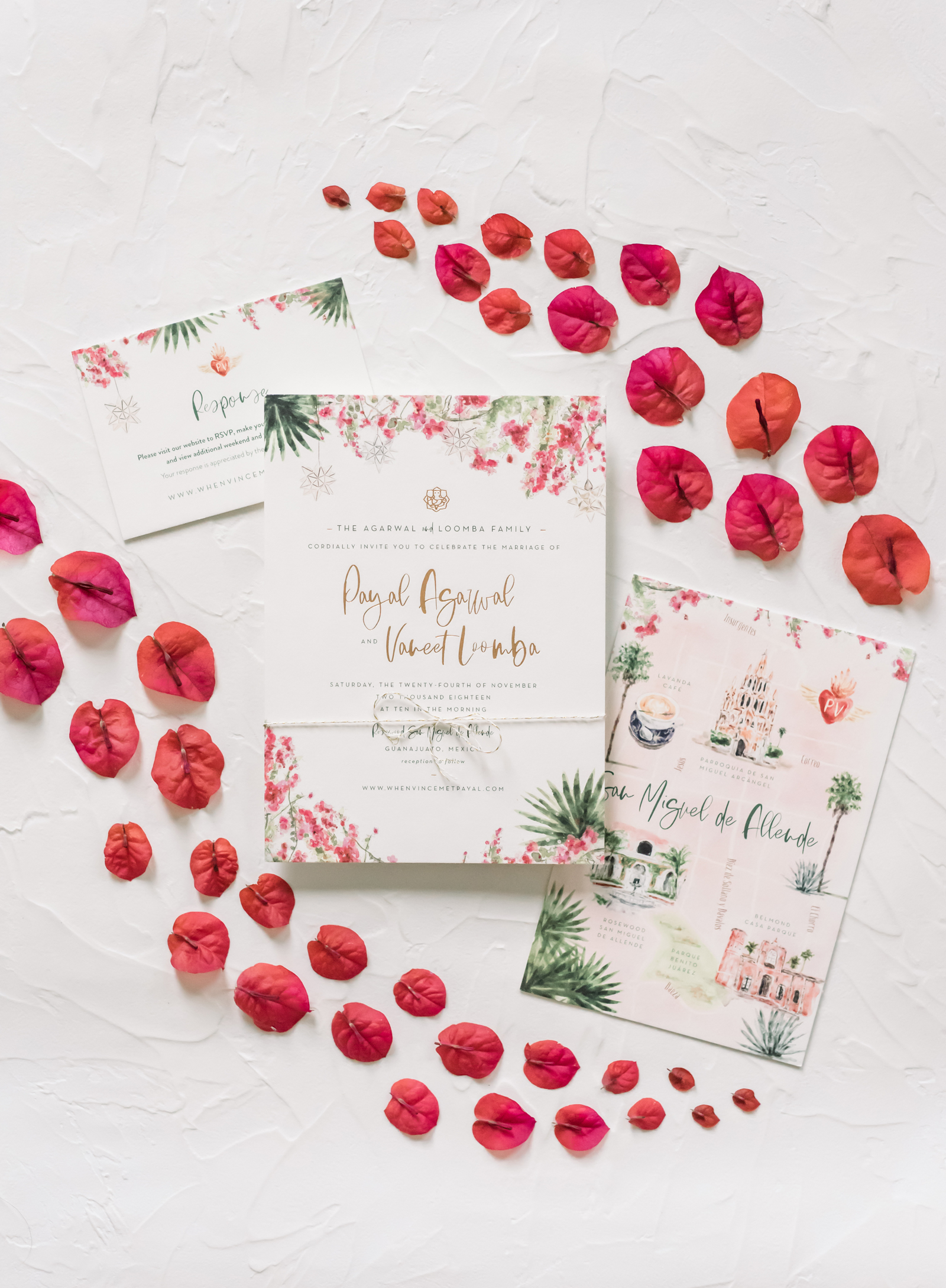 white stationary invitations with watercolor designs to match wedding theme